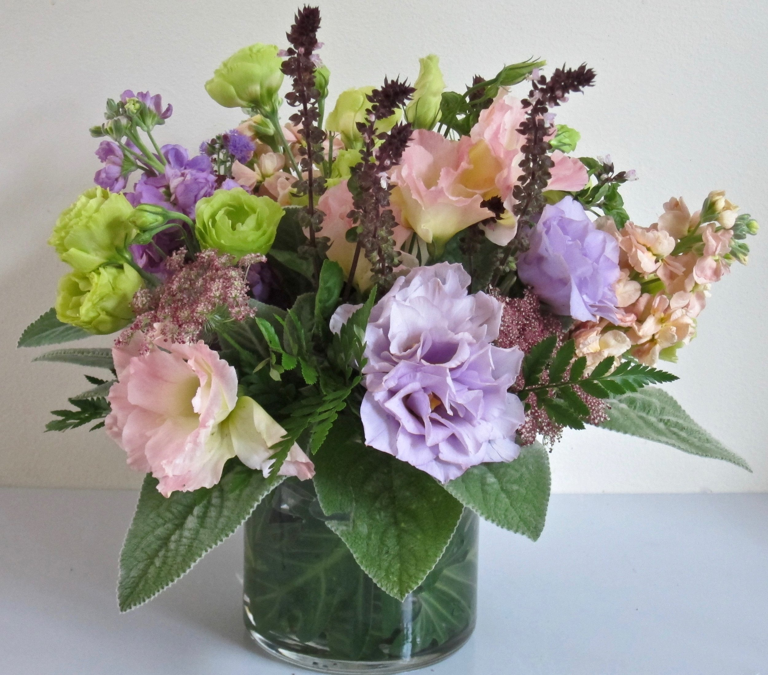 LISIANTHUS,     cinnamon basil, lambs ear and other accents   in a leaf-lined or clear vase, $55.
