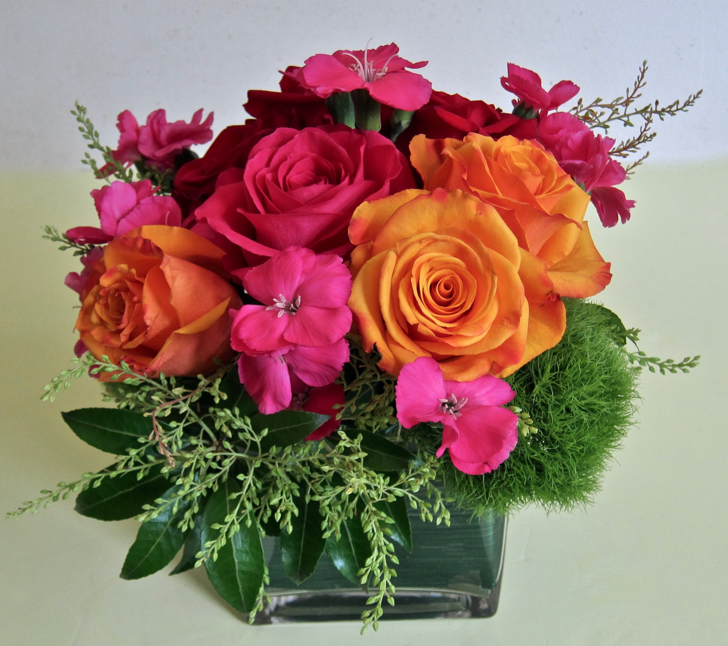 VIBRANT,   bold colors in a cube vase ranging from $60 to $90, depending on flower selections and size.