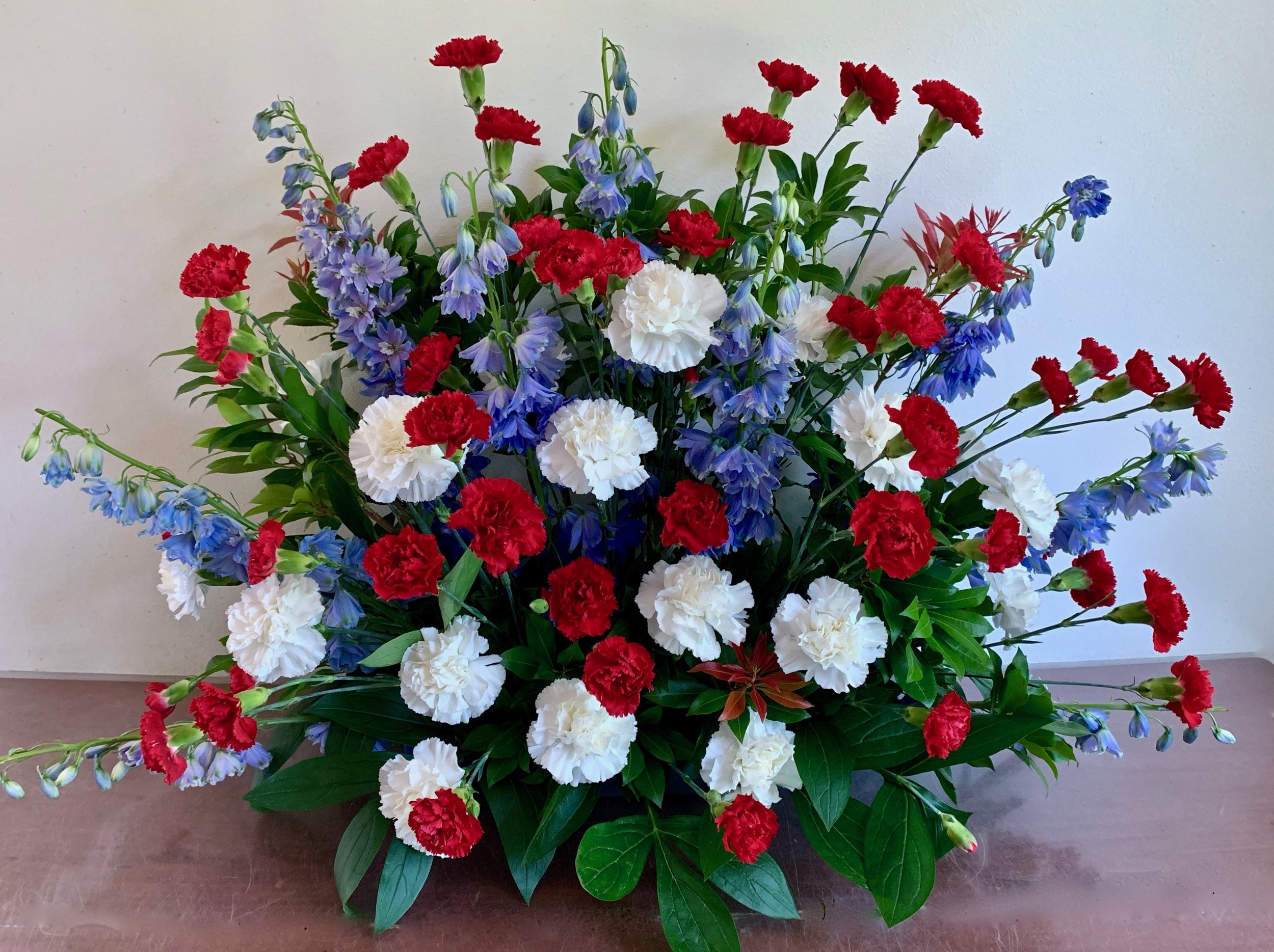 PATRIOT    Spray of red, white and blue flowers,  $120.