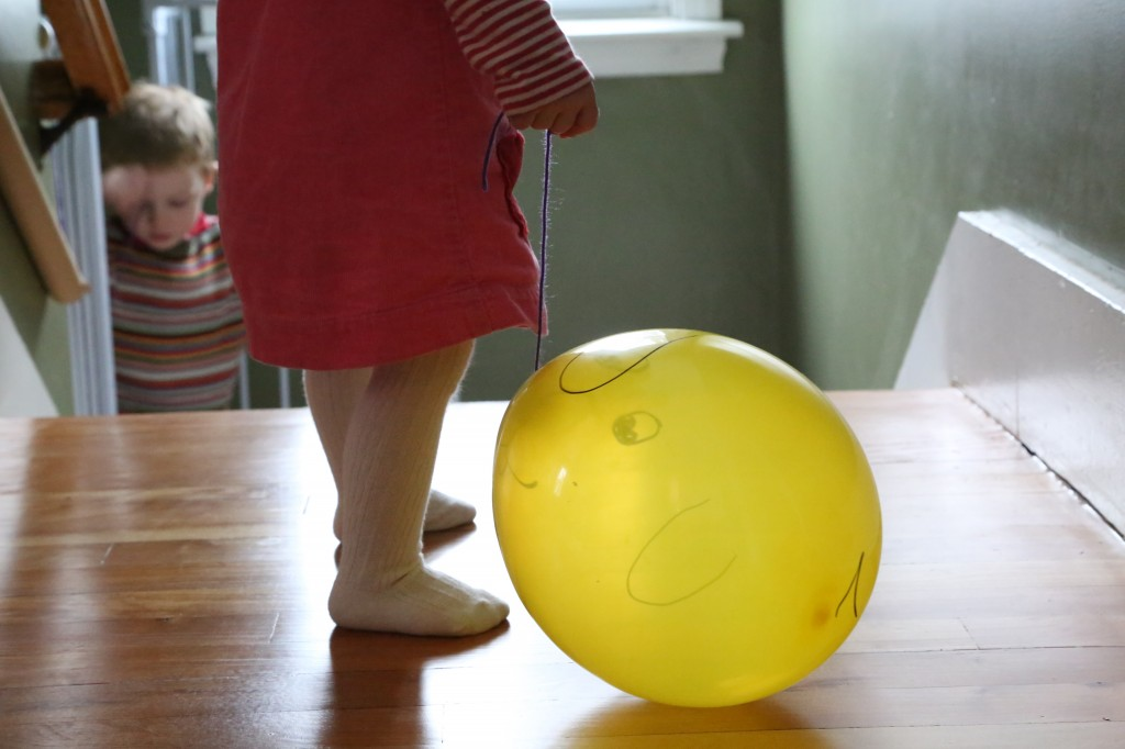 How to entertain toddlers on a snow day: taking balloon puppies for a walk around the house