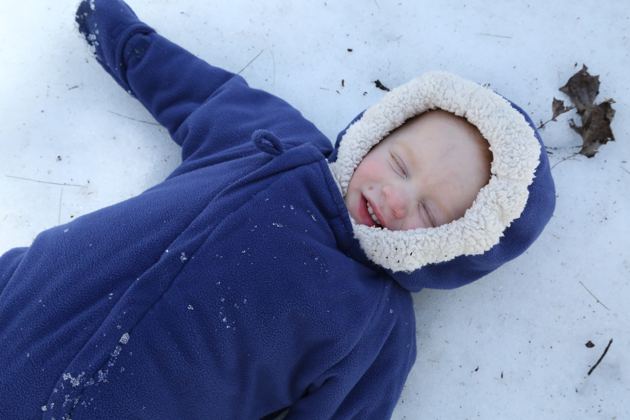 She was very happy when I laid down by her and she snuggled deep in her baby snowsuit.