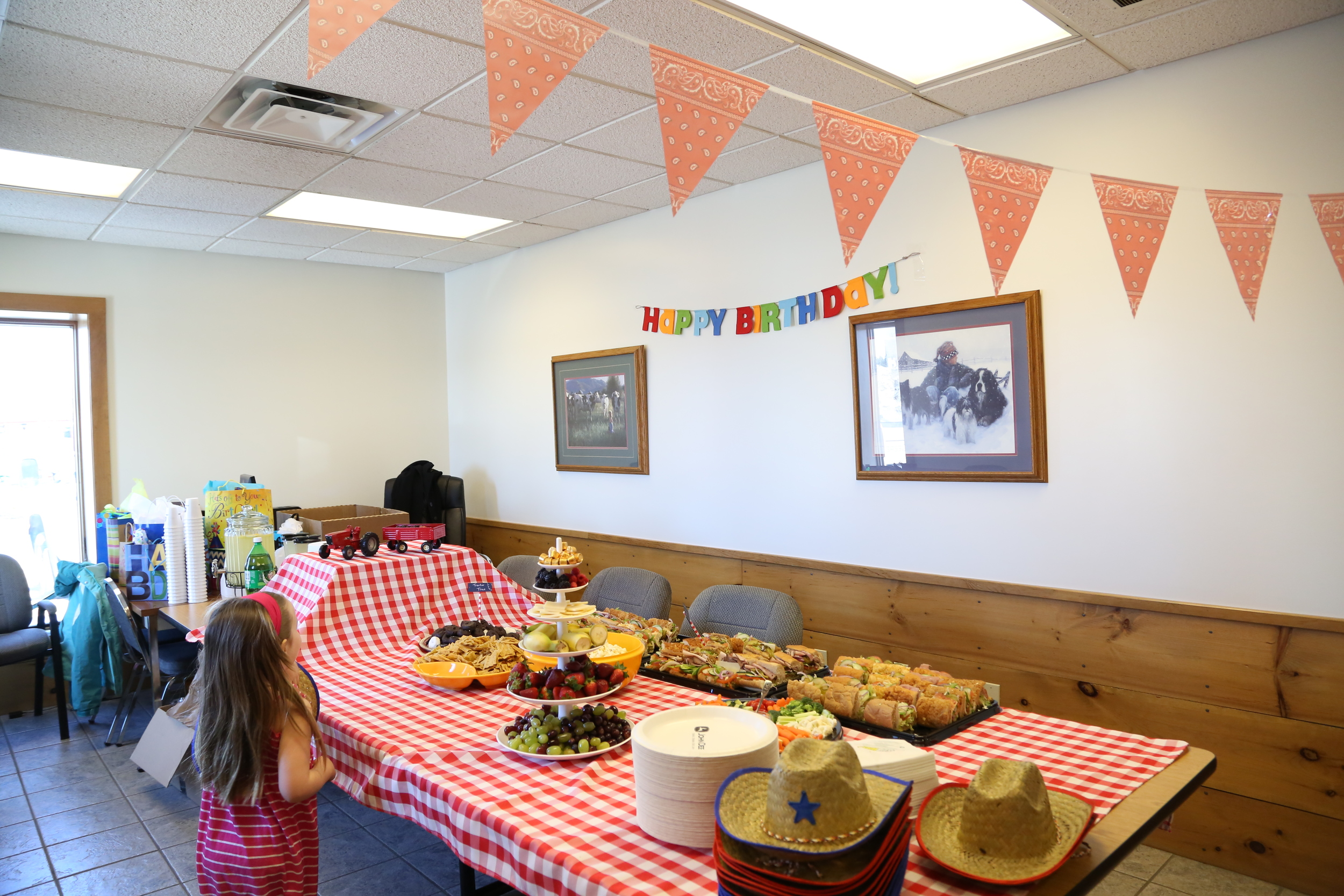 """The spread - Subway catering, lemonade, fruit/cheese/chocolate platter, """"tractor tire"""" donuts, veggie tray & dip I cut up myself because the grocery store wanted $44 for one veggie tray, with adult-sized bites  (seriously?!) So I chopped the veggies into toddler-size pieces myself."""