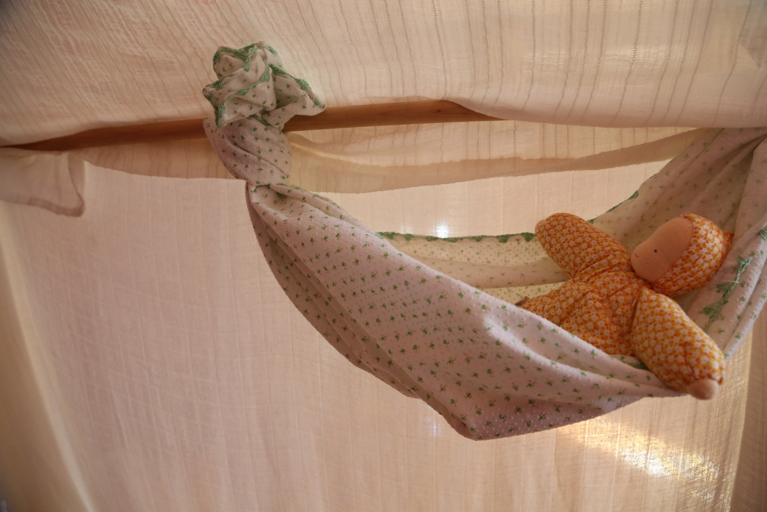 We tied a babydoll hammock in there one day.  Sometimes G puts blocks or other toys in there.