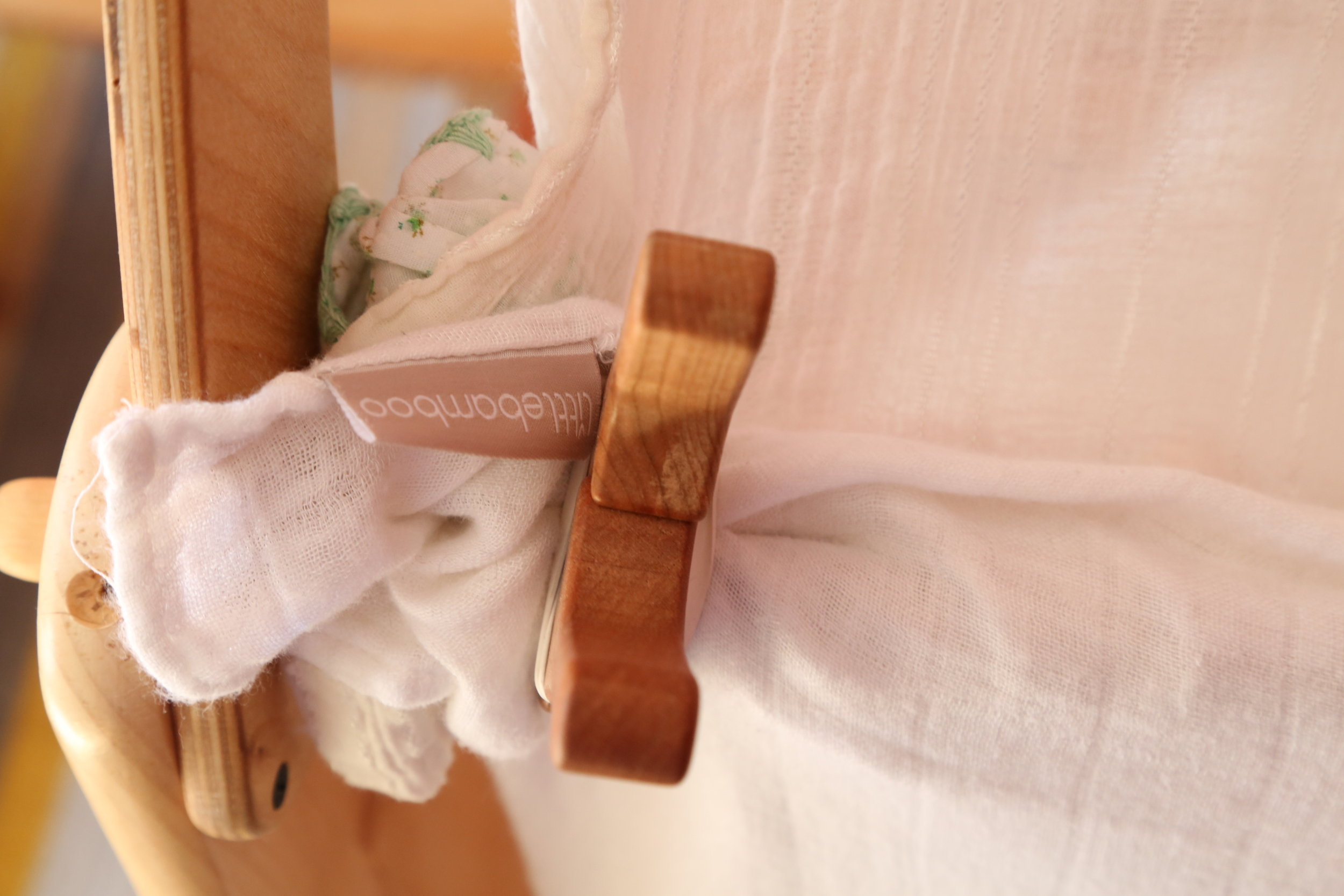 Giant, easy to open clothespins clip around dowels so they can build with cloth.