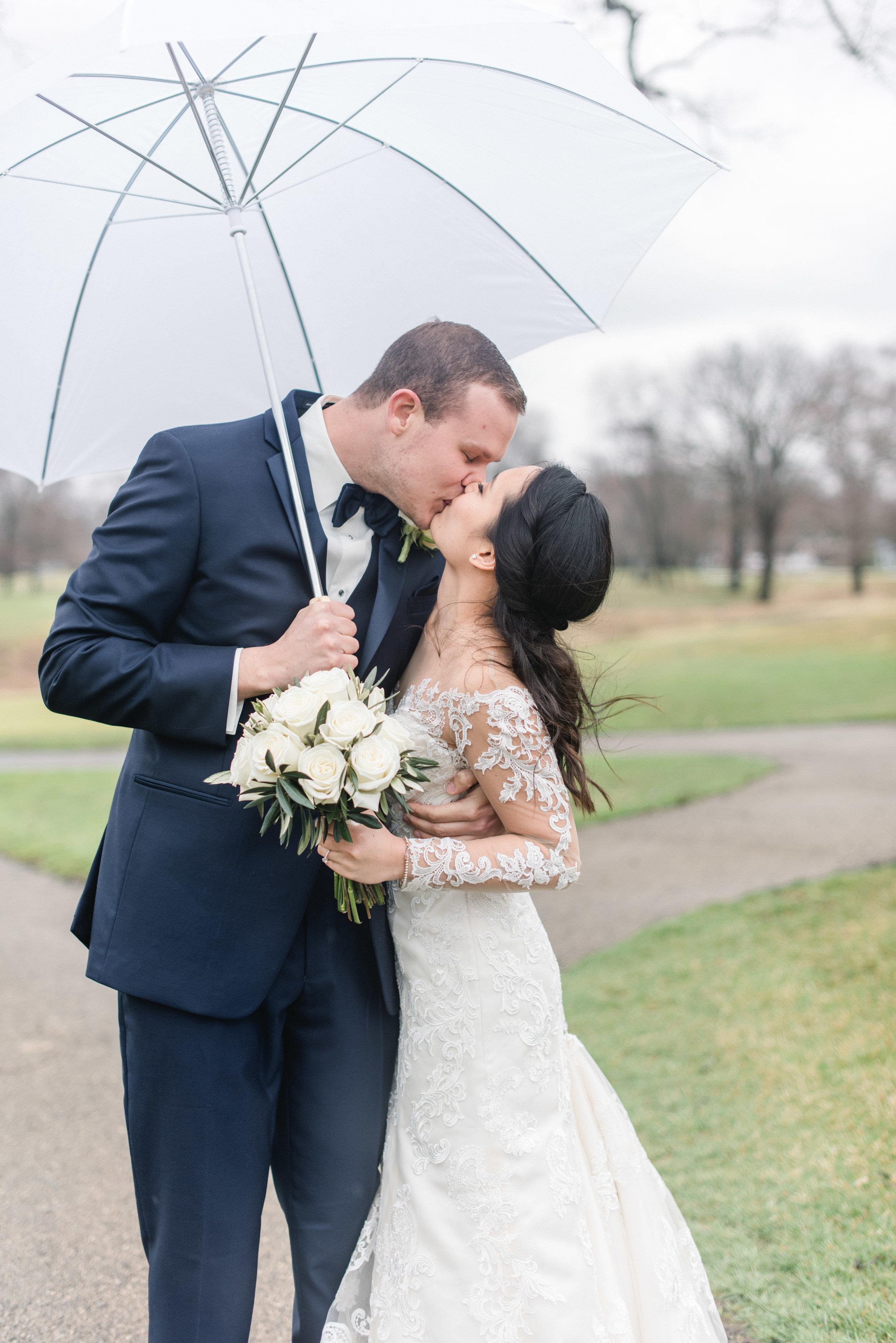 bride and groom umbrella.jpg