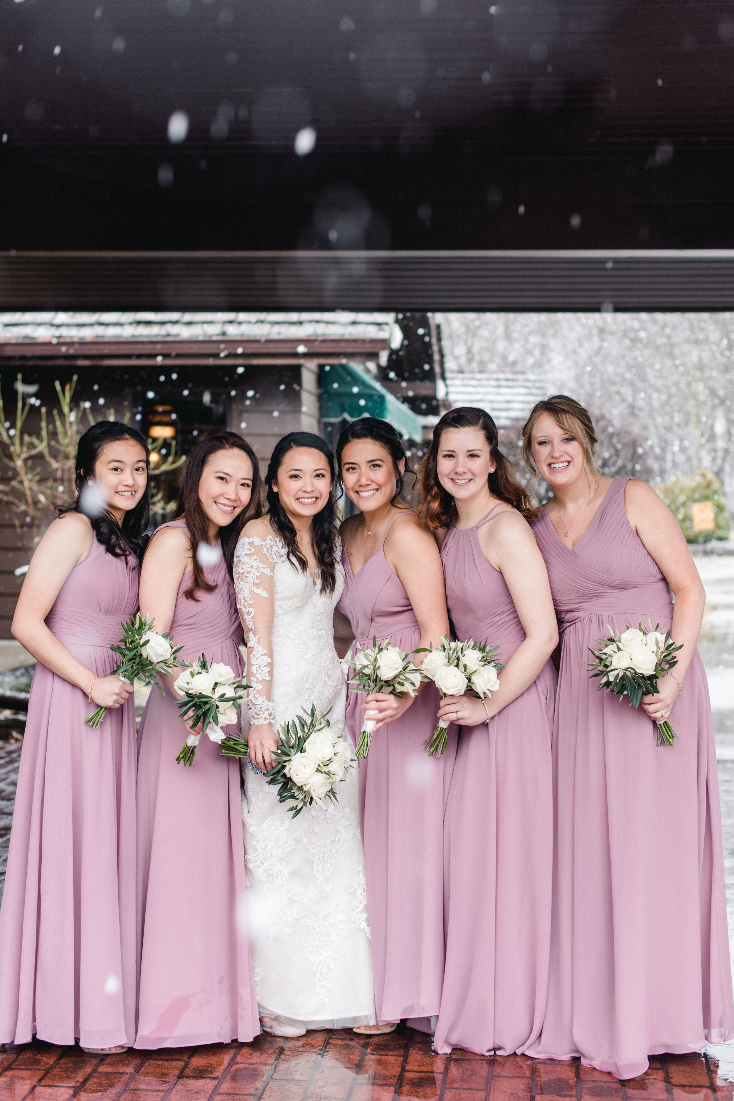 Bridesmaids with snow Lafayette Country Club.jpg