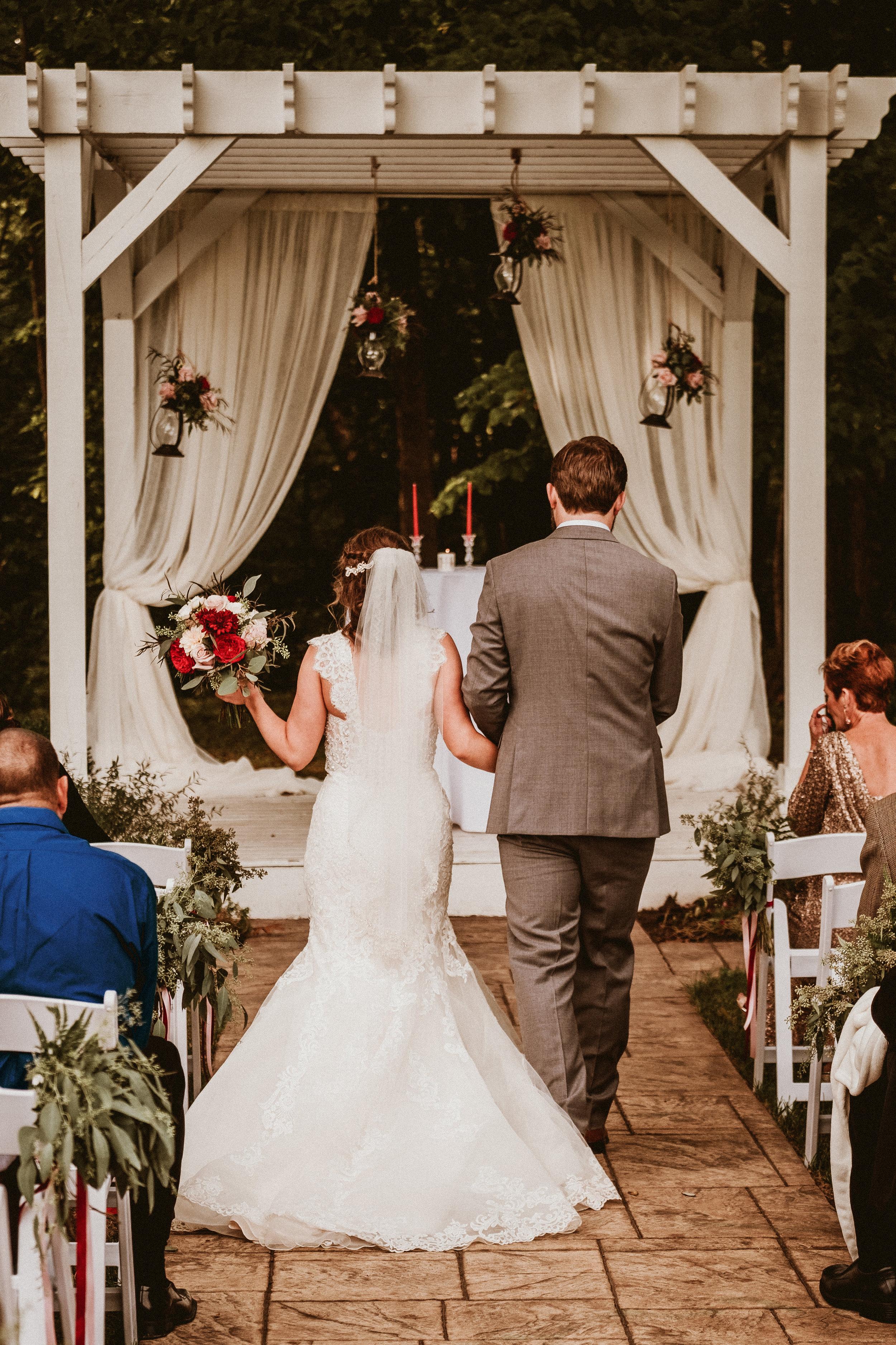 Fall Wedding Flowers bouquet hangind lanterns aisl greens.jpg