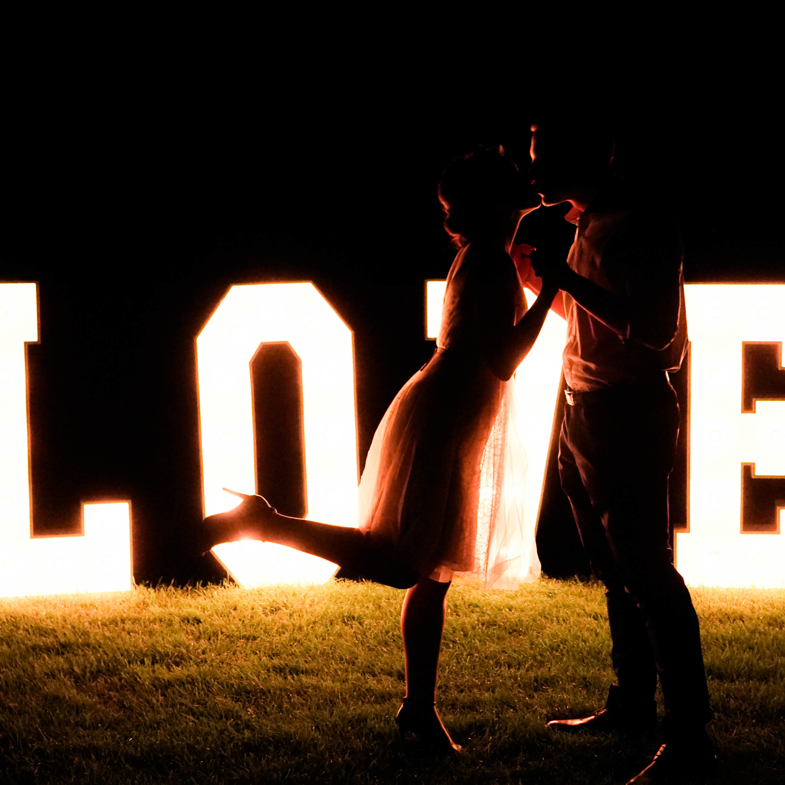 awsome couple with the love sign