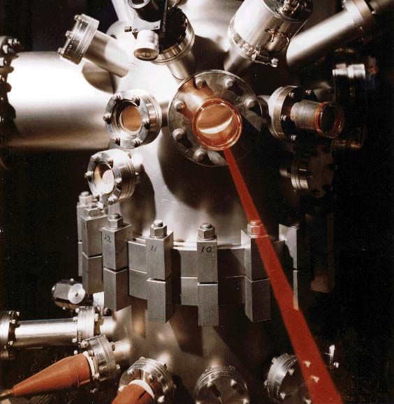 Vacuum chamber in operation in Laser Damage Facility; China Lake optical and laser research since 1962 has included significant contributions in surface and laser-damage characterization, component polishing, diamond-turned optics, and special coatings.
