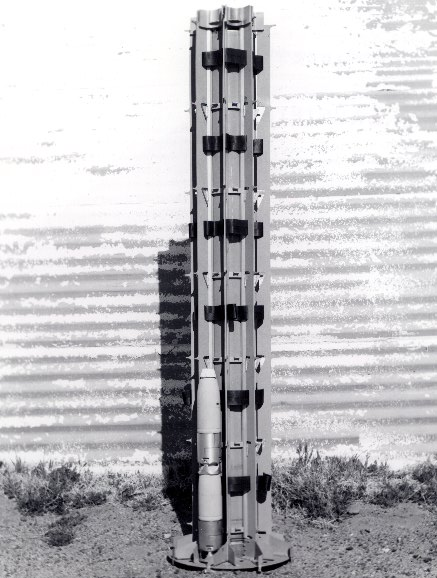 """One of the earliest results of the Free-Fall Weapons Studies, the Hawkeye cluster weapon (the banded mandrel--internal structure--shown here); the submunitions were modified 2.75-inch rocket warheads, prompting the name change to Rockeye I, which was cancelled in favor of the Rockeye II (still in service); China Lake's """"Eye"""" series of free-falls was a direct result of the Studies."""