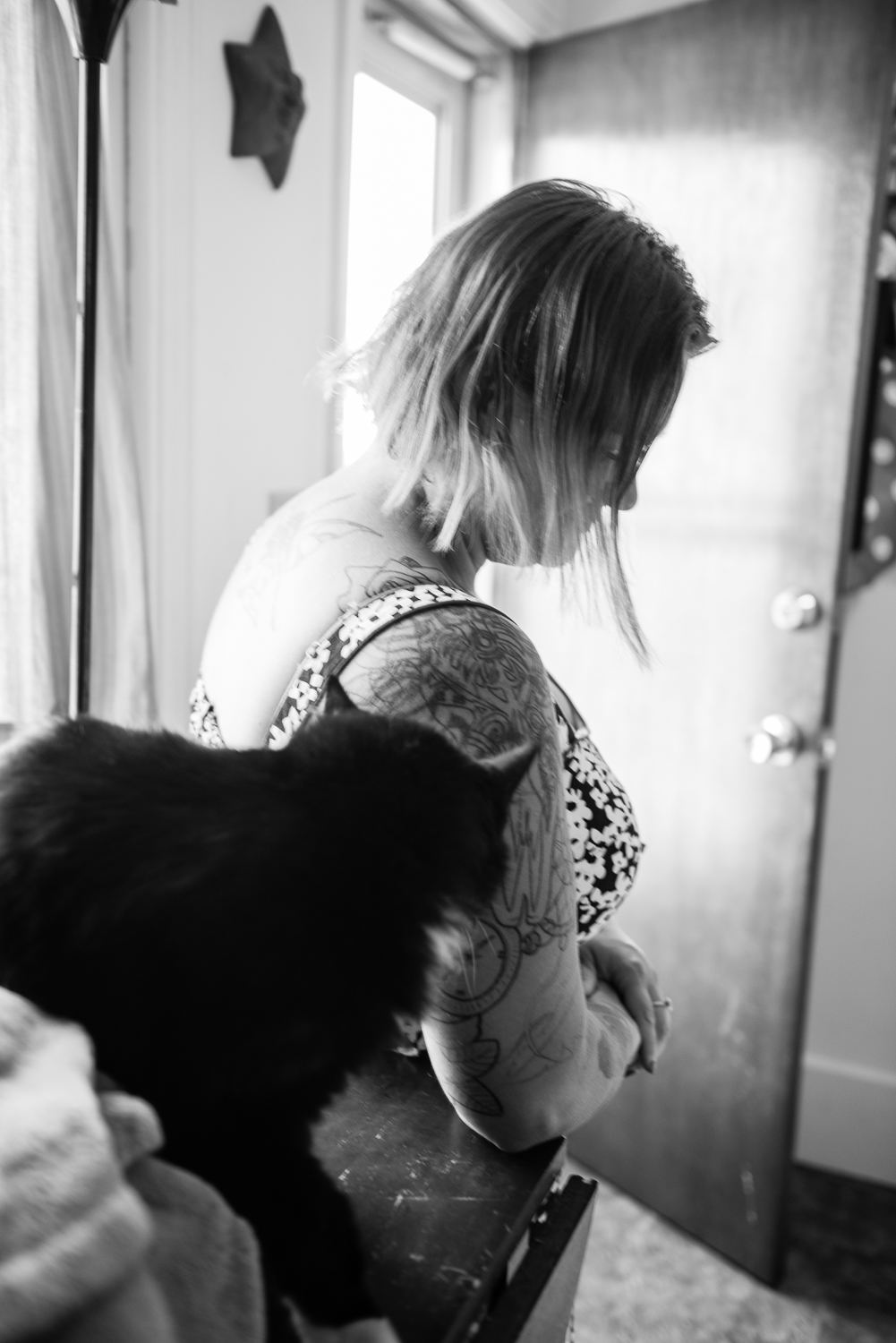 Michelle with her cat who had accompanied her and her kids on their cross-state Amtrak move. Upon arrival, they lived in a shelter.