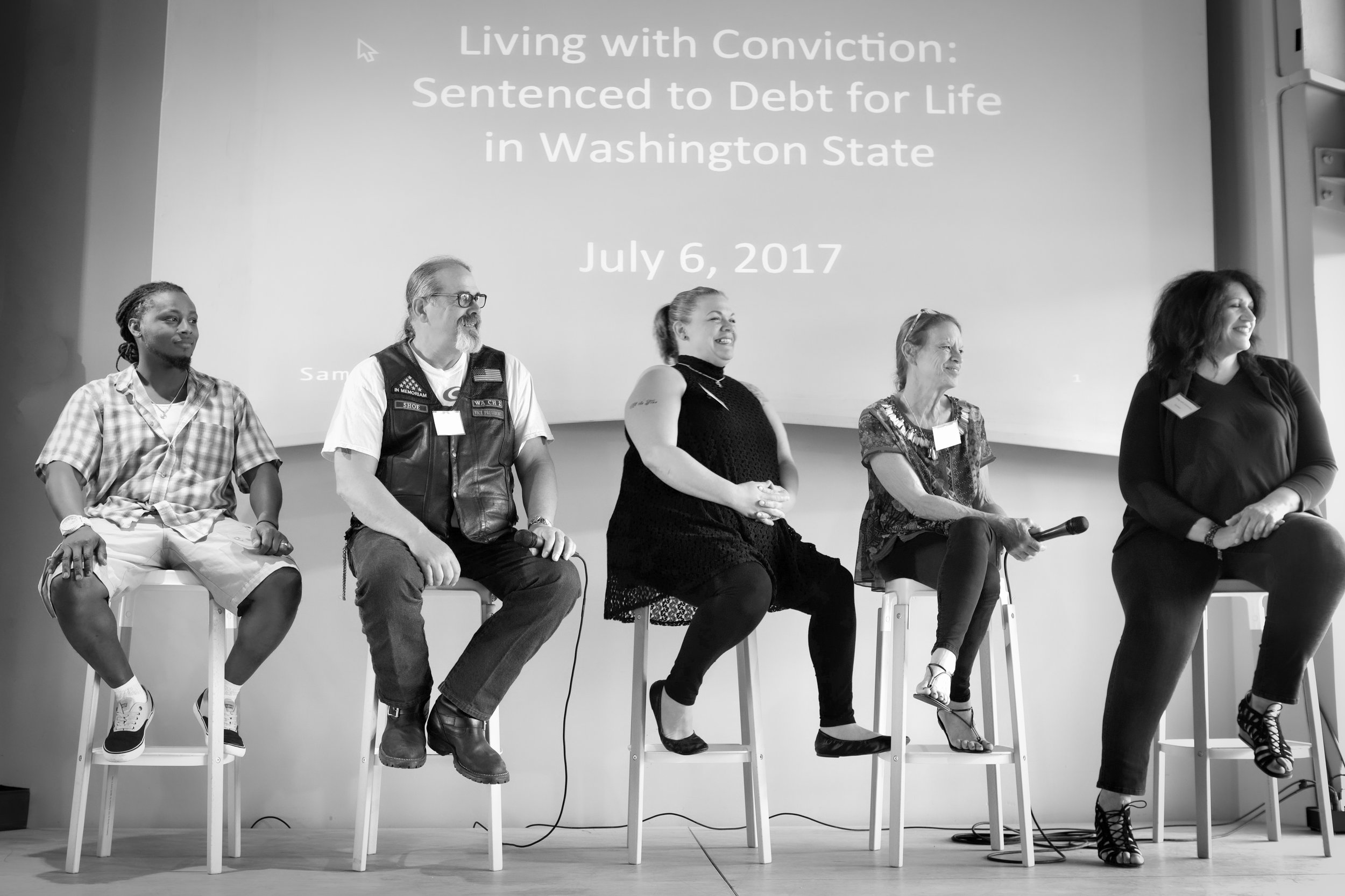 The first Living with Conviction panel on July 6, 2017 at the Impact Hub in Seattle, Washington. From left to right, Rickey Roberson, Michael Shoemaker, Sabrina Helton, Maureen Caputo, and Carmen Pacheco Jones. Photo courtesy of Constance Brinkley.