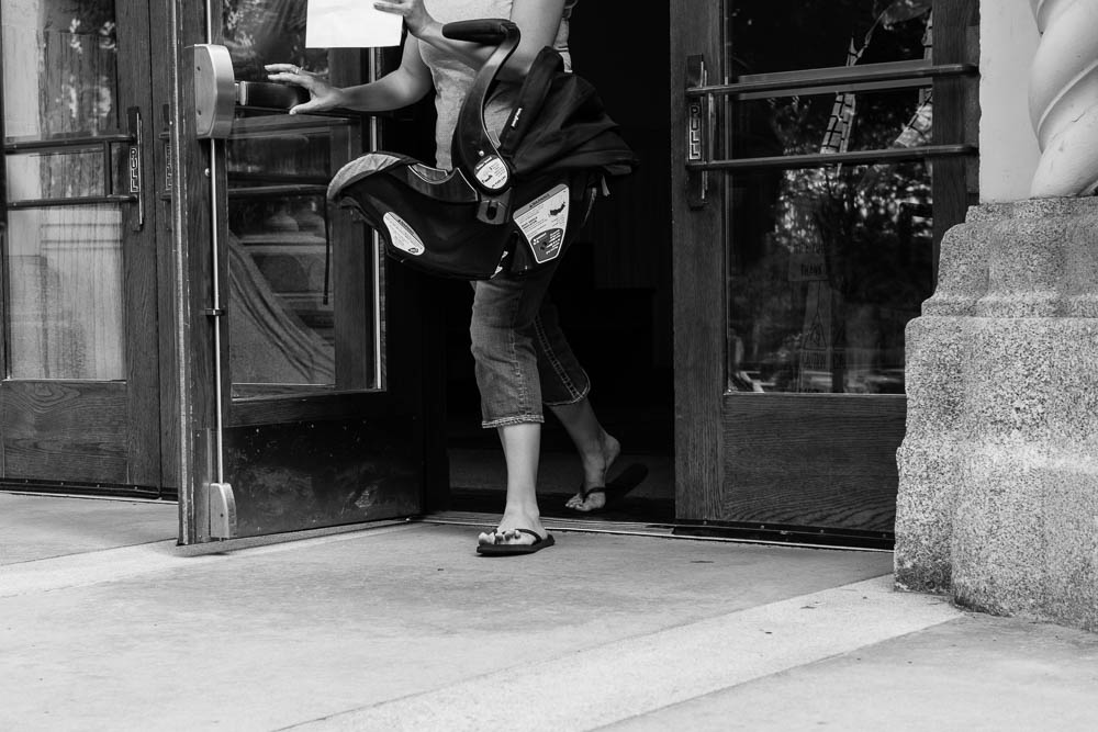 A woman and child leaving the Spokane County Courthouse.