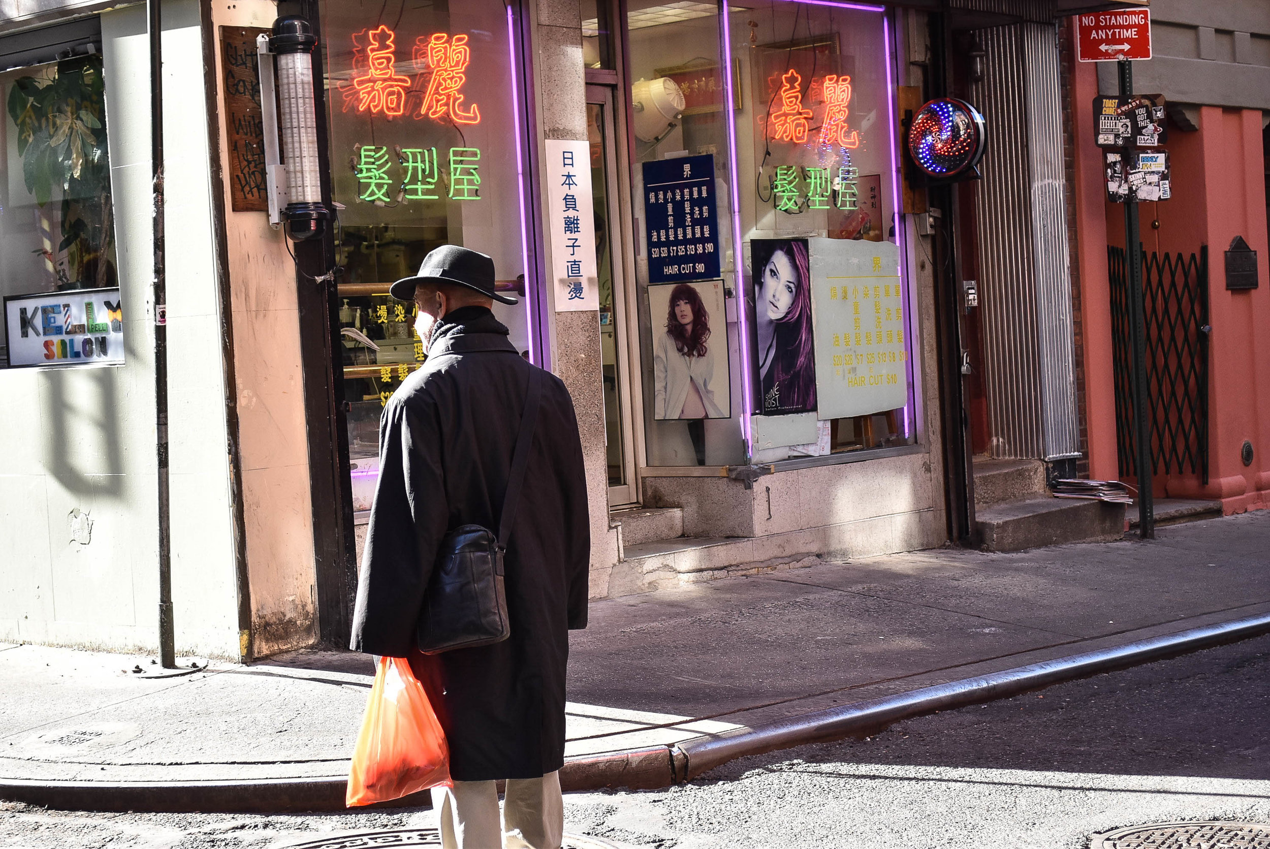 Older gentleman waiting with a bag of fish, Chinatown, NYC - Nov 2016
