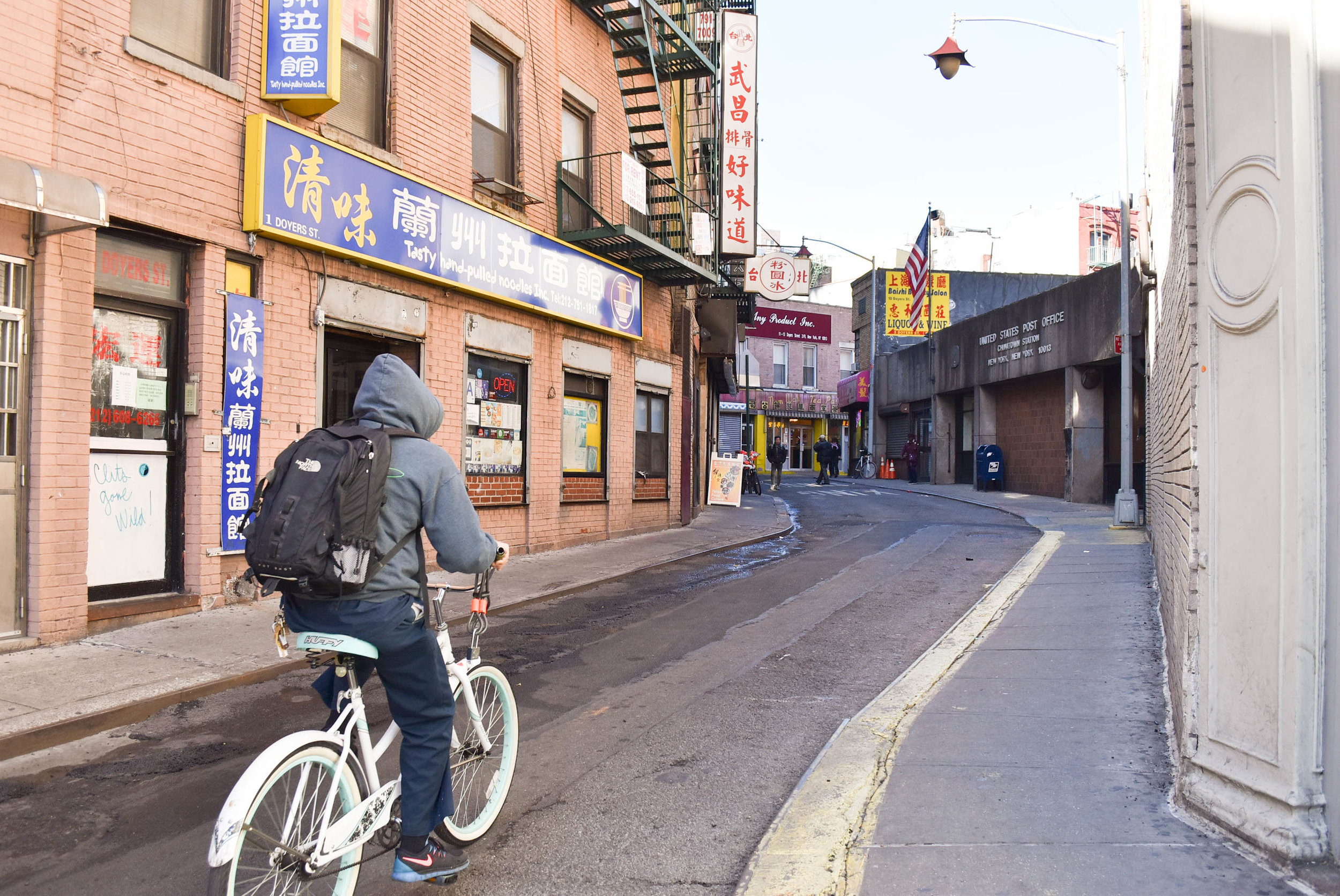 Man in bike, Chinatown, NYC
