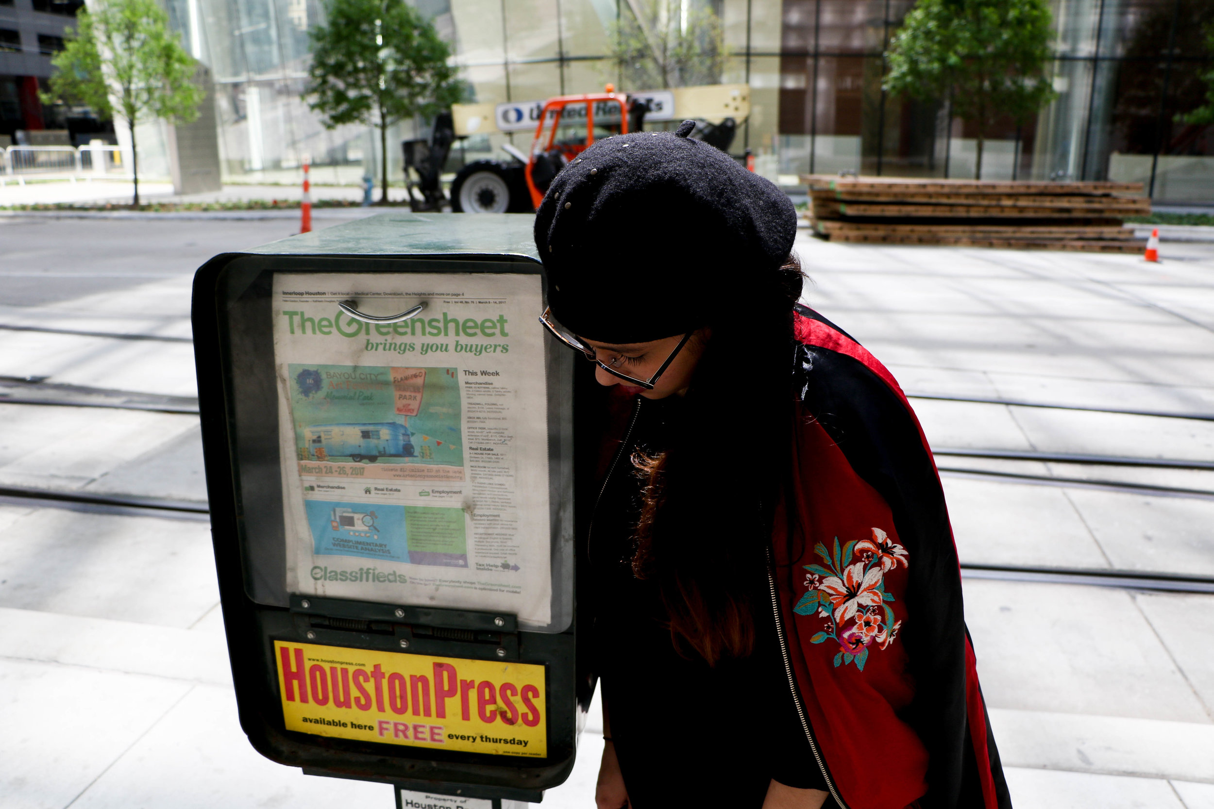 Me, taking a walk and becoming friends with a newspaper dispenser in Downtown Houston.