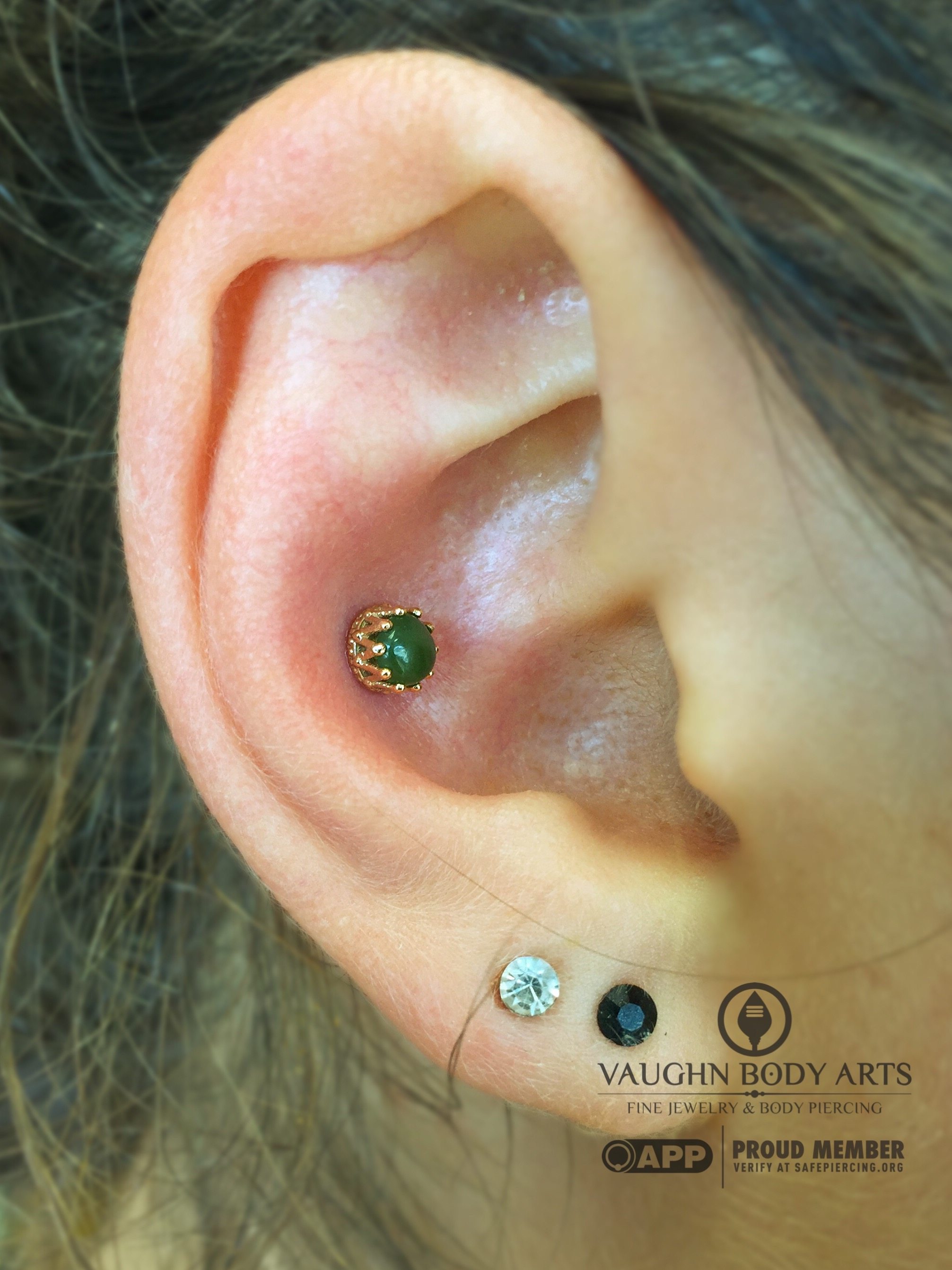 """Conch piercing with an 18k yellow gold """"King"""" end featuring genuine Jade from Anatometal."""