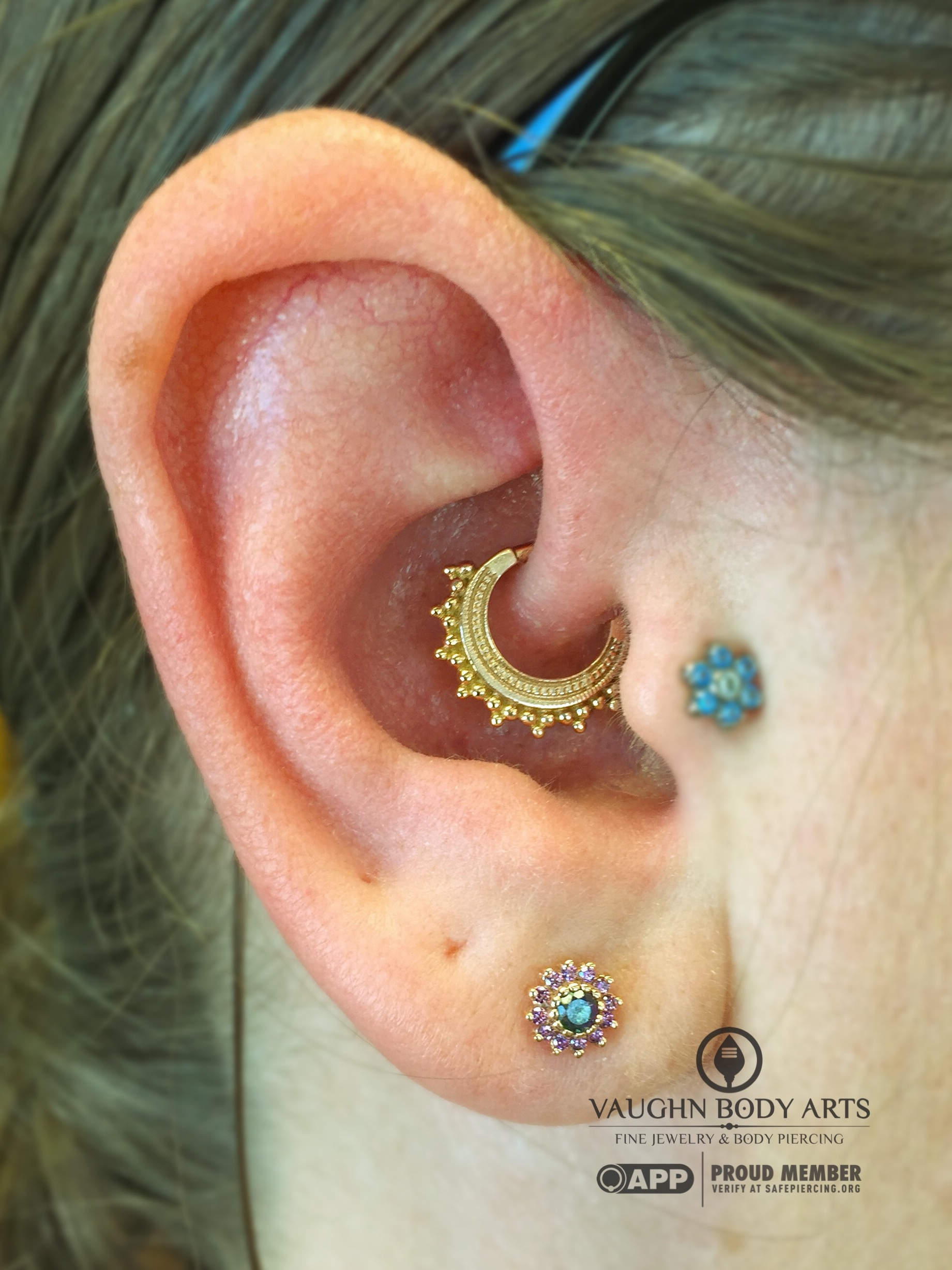 """Daith piercing featuring a 14k yellow gold """"Afghan"""" hinged ring from BVLA."""