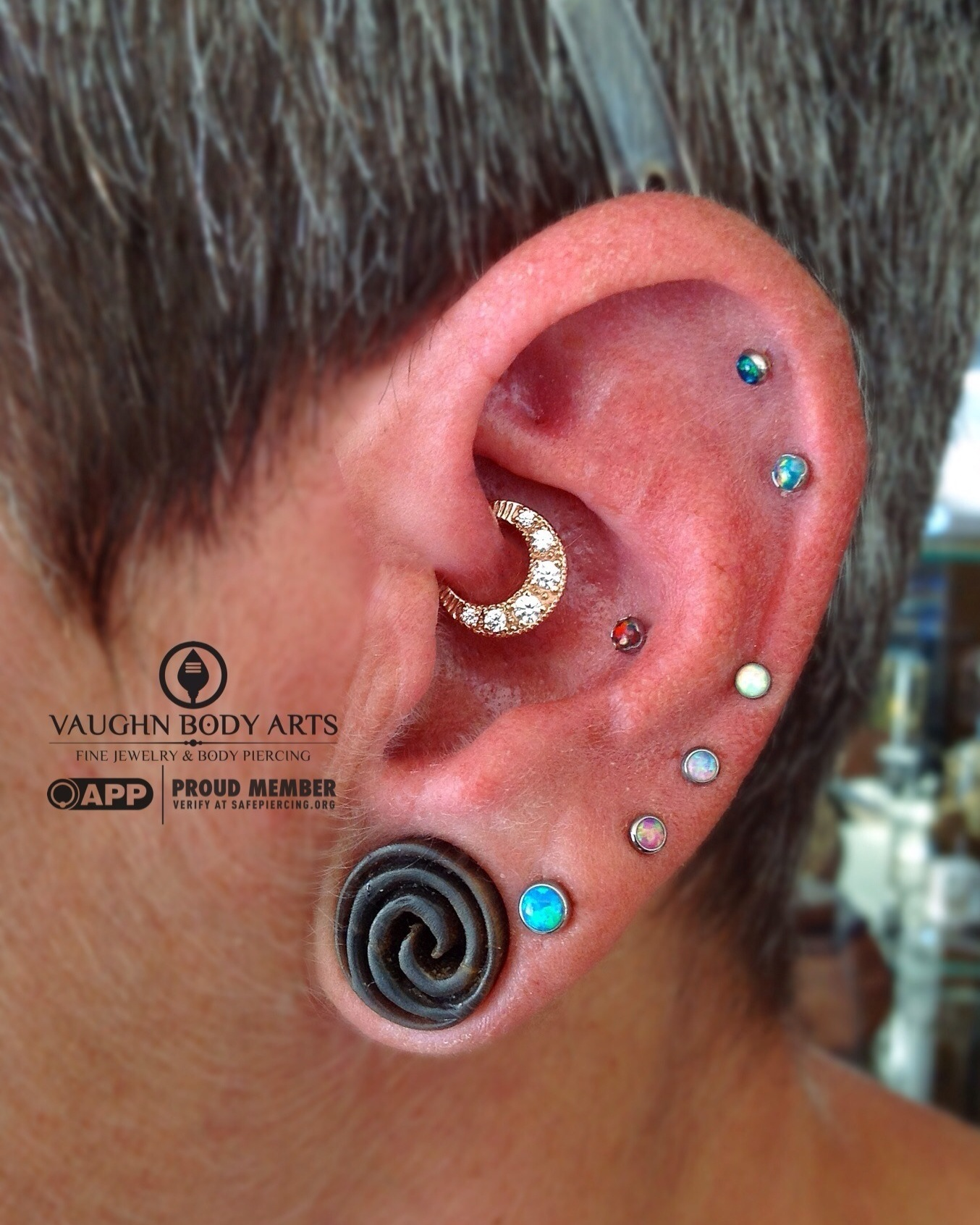 """Daith piercing featuring a 14k yellow gold """"Bombay Twilight"""" hinged ring with clear cz's from BVLA."""