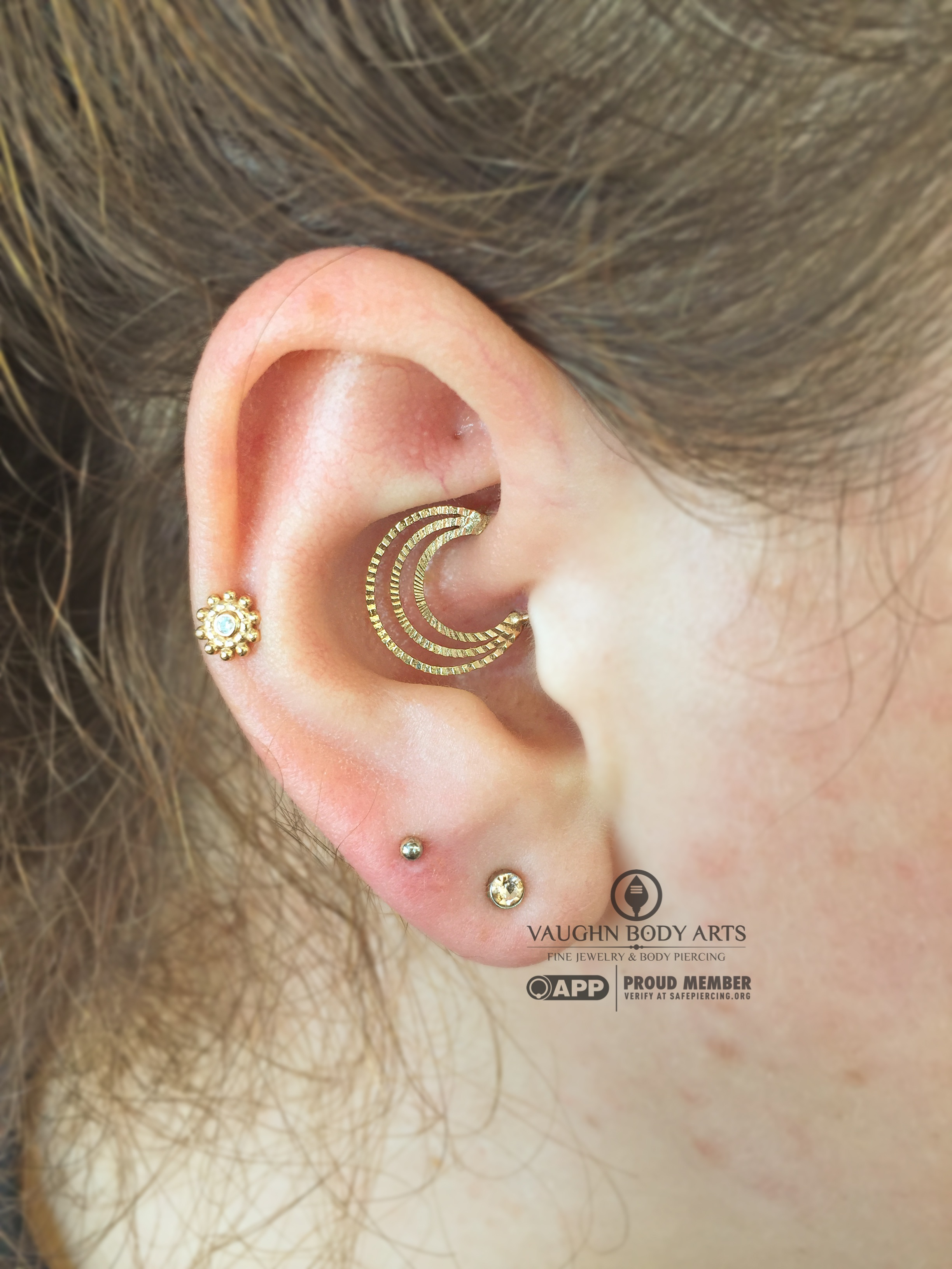 Daith piercing featuring 14k yellow gold jewelry from Quetzalli Jewelry.