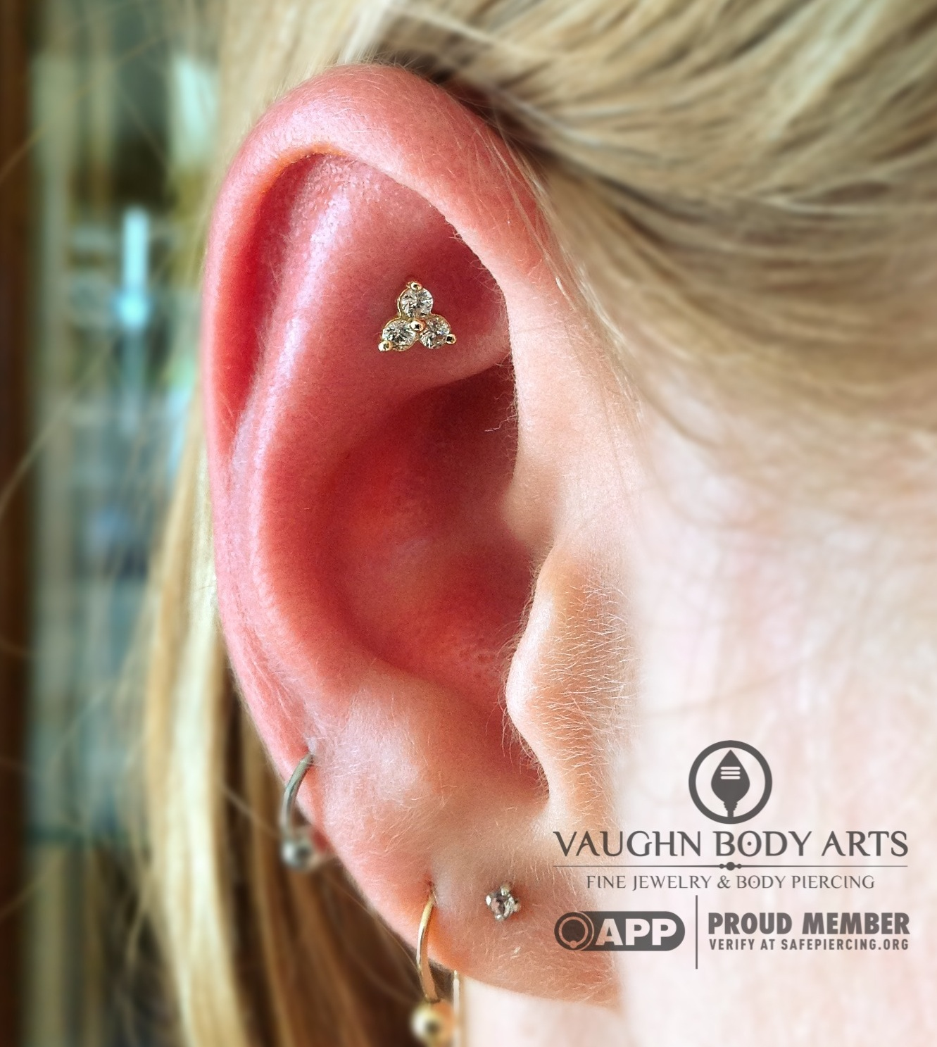 """Faux rook piercing with a 14k yellow gold """"Trinity"""" end from NeoMetal."""