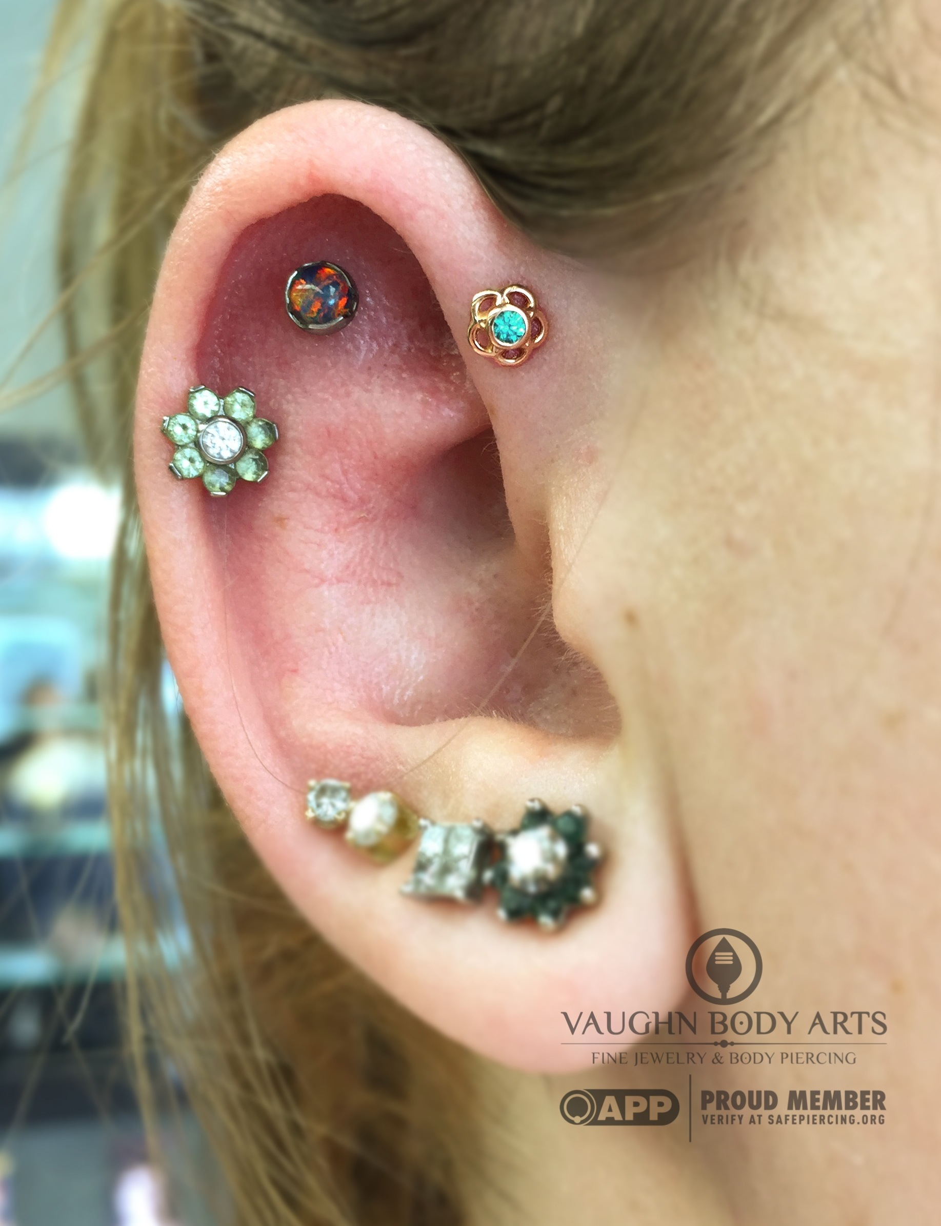 """Forward helix piercing with an 18k rose gold and mint green cz """"Tama"""" end from Anatometal."""