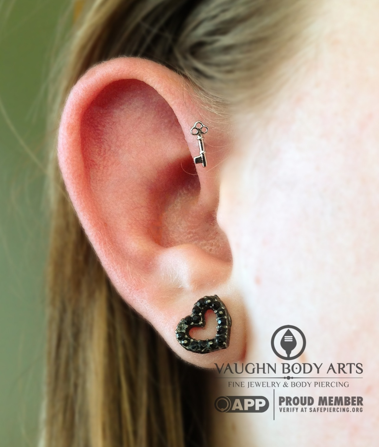 """Forward helix piercing with a 14k white gold """"Tiny Key"""" end from BVLA."""