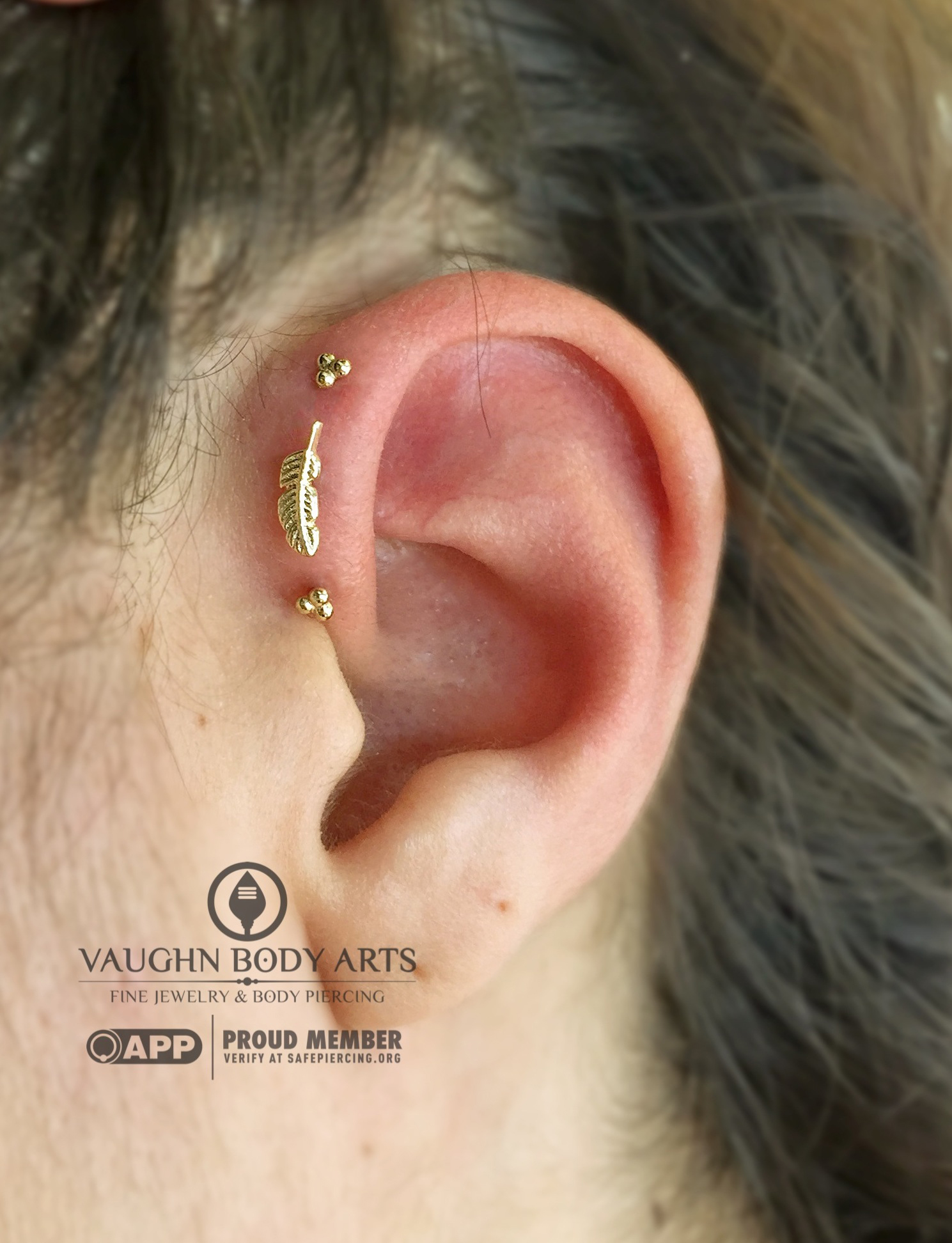 Triple forward helix piercings with 14k yellow gold jewelry from BVLA.