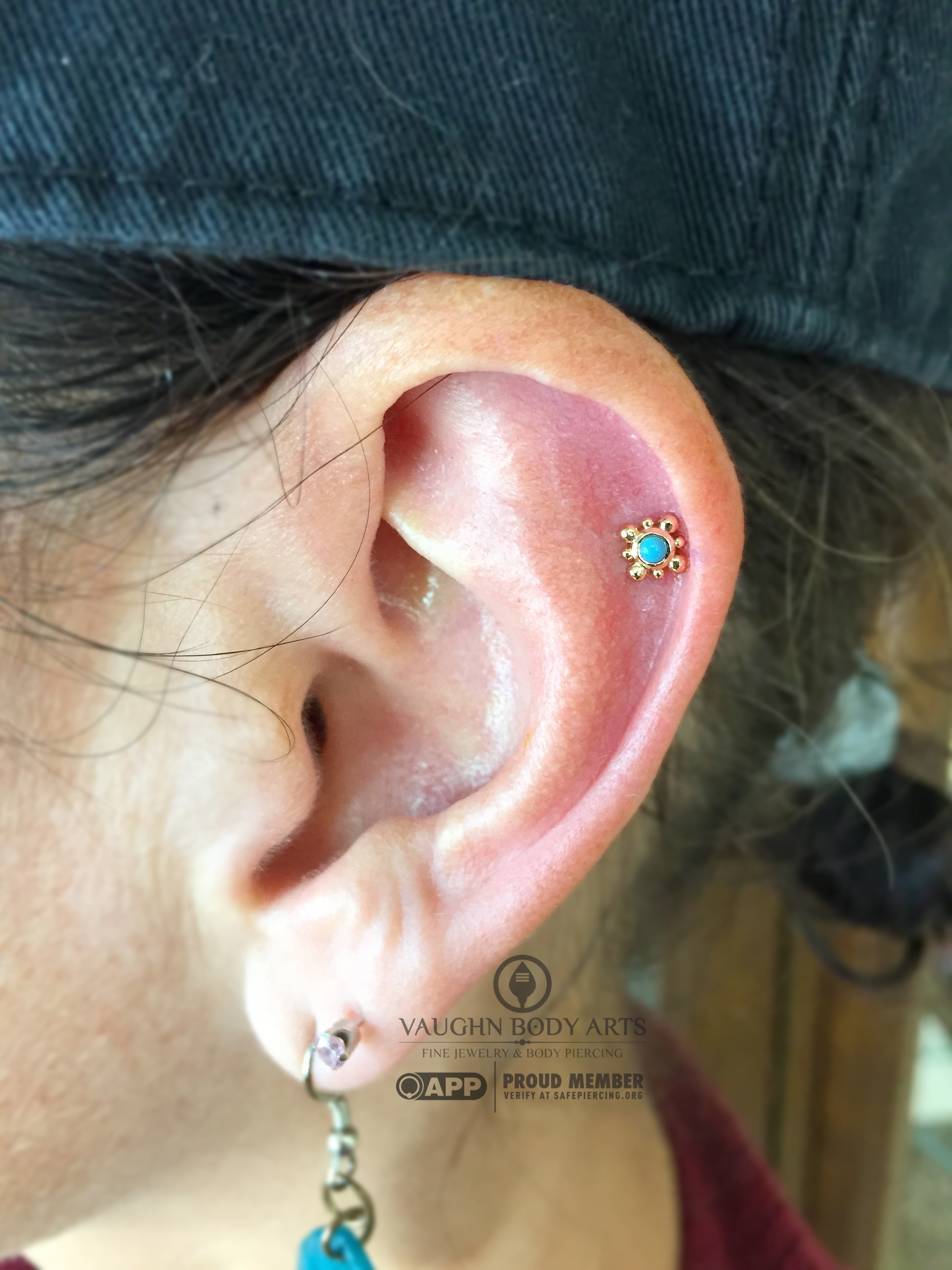 """Helix piercing with a 14k yellow gold and turquoise """"Bali"""" end from NeoMetal."""