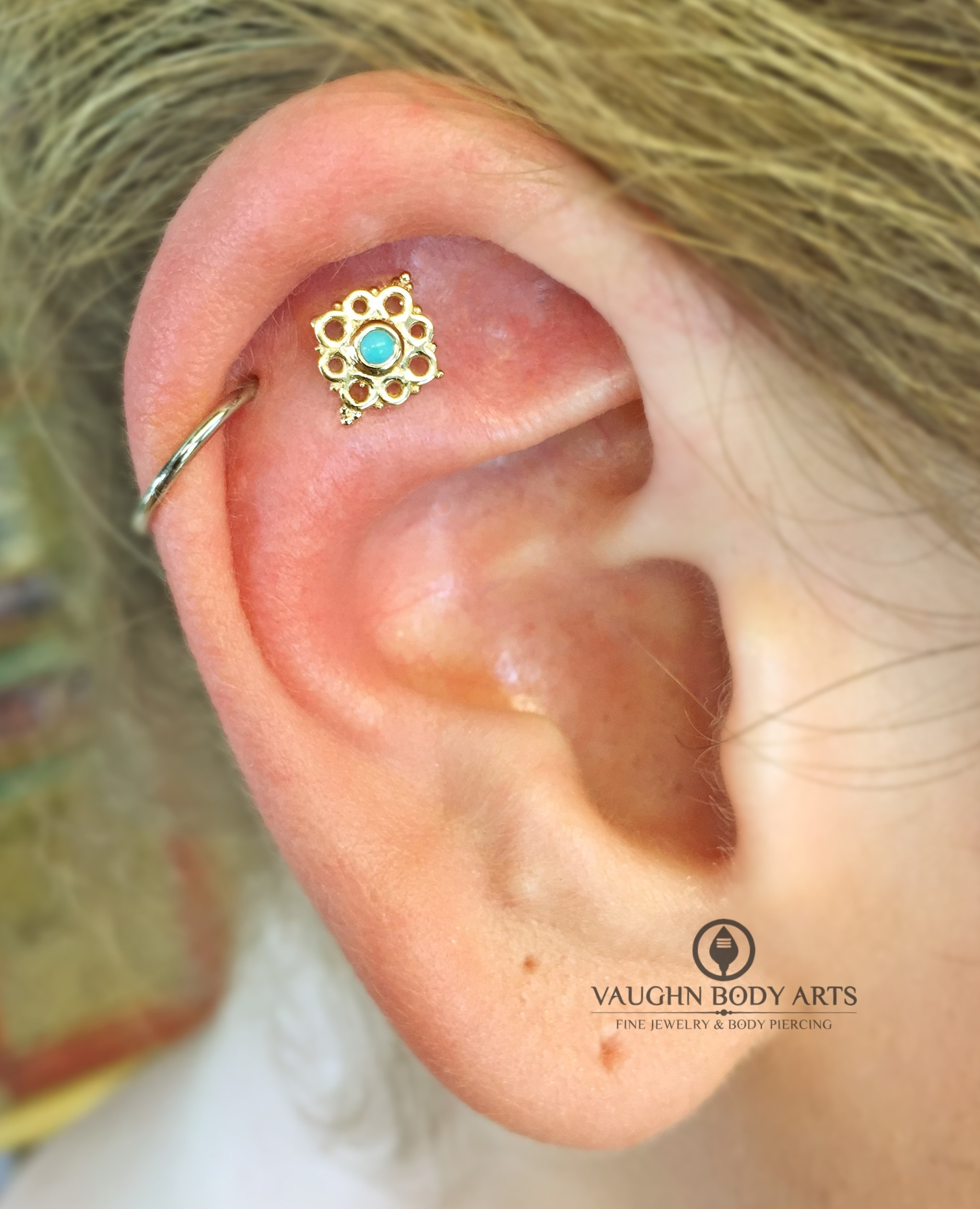 """Helix with a 14k yellow gold and turquoise """"Angela"""" end from BVLA."""