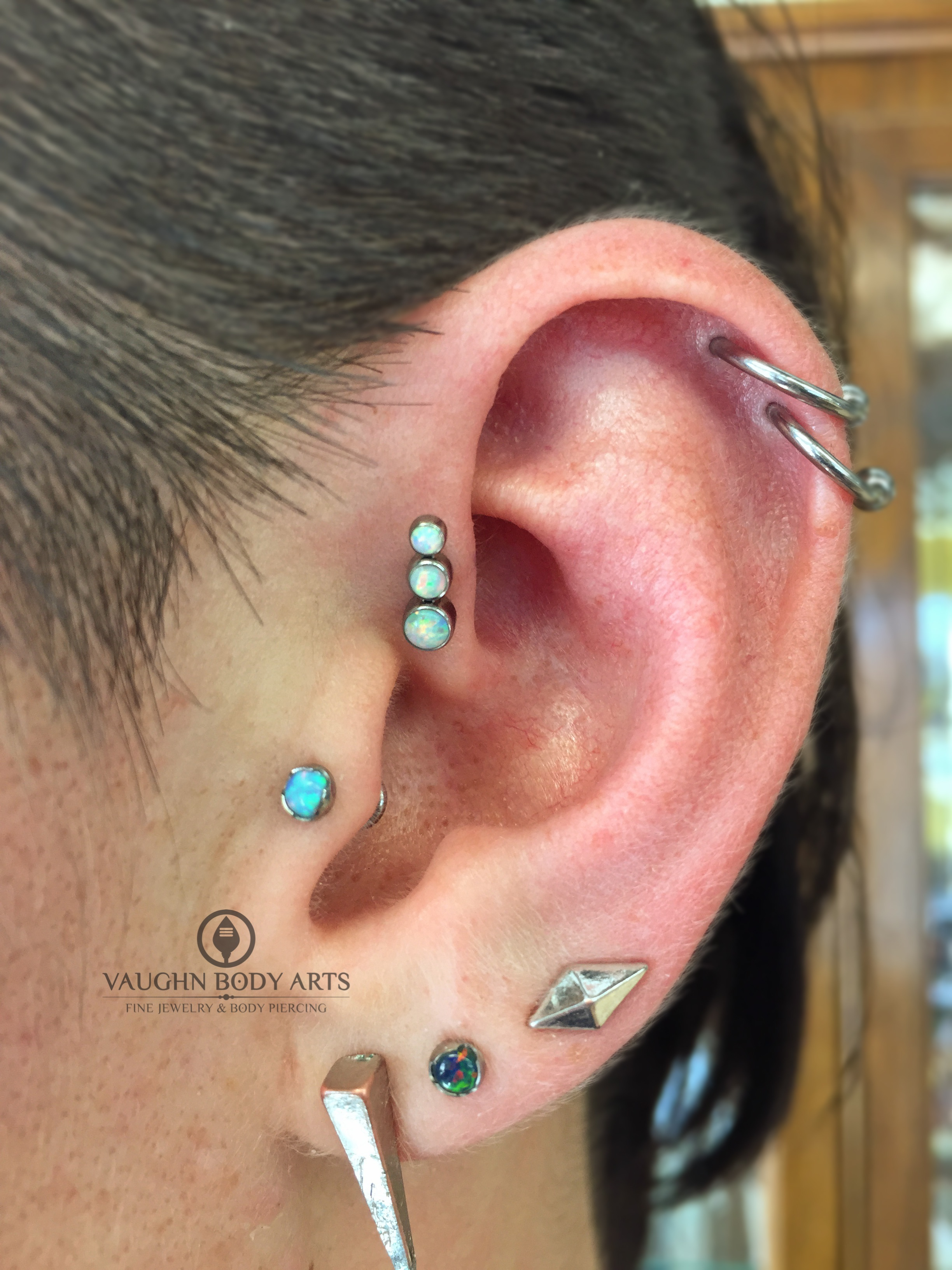 Forward helix piercing with titanium gem cluster from Anatometal.