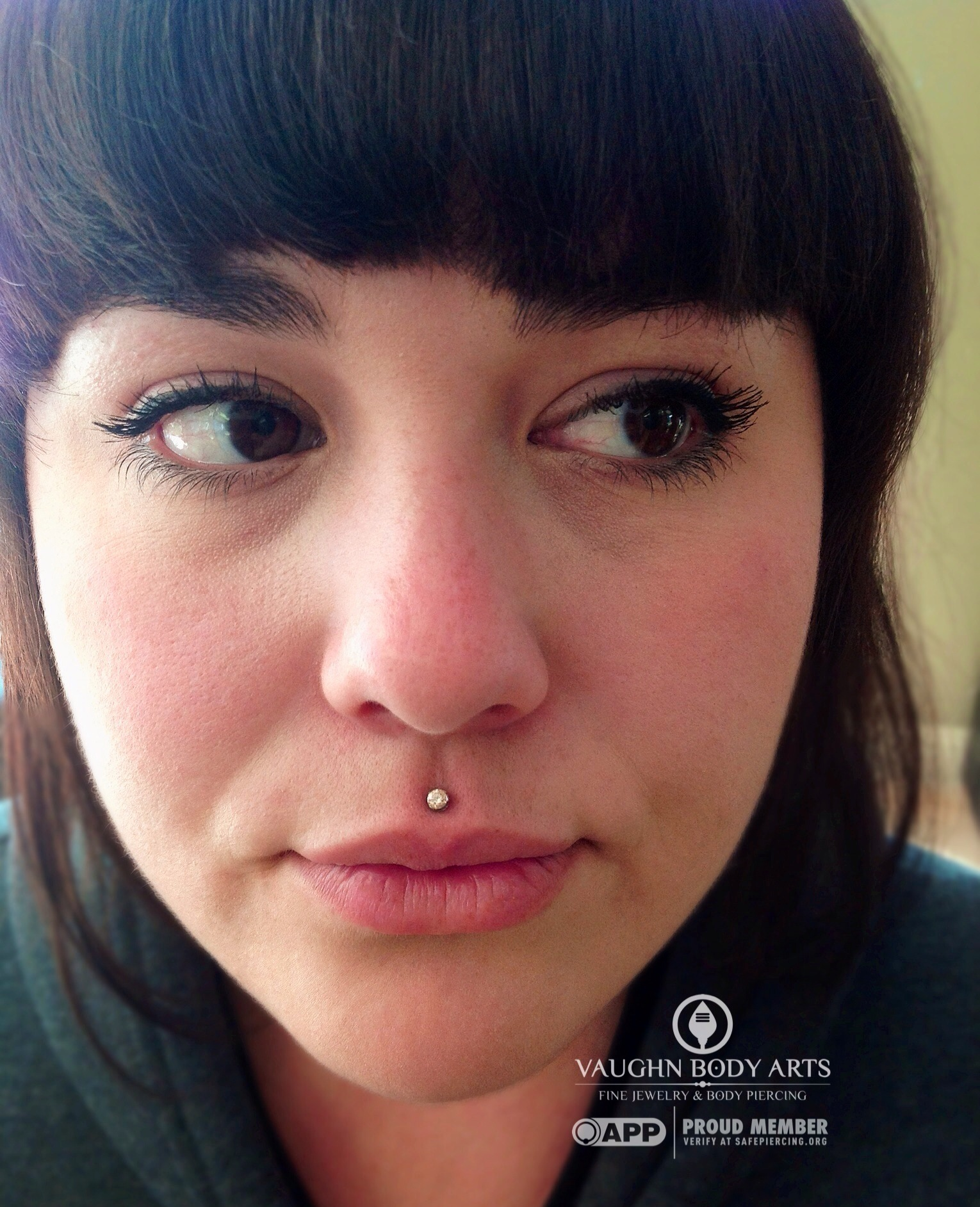 Philtrum piercing with titanium and champagne cz jewelry from Anatometal.