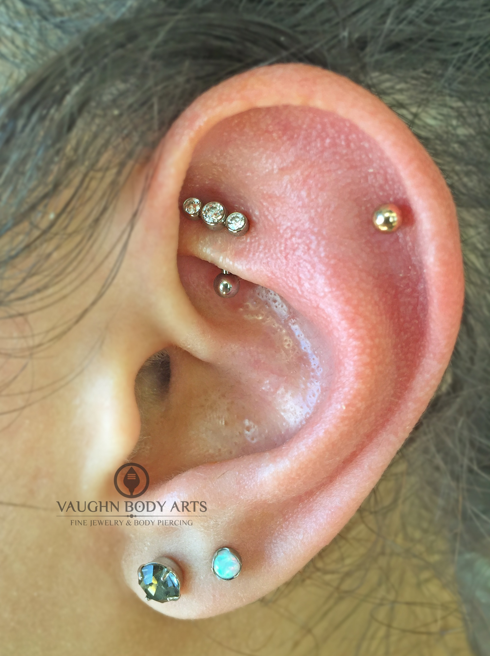 Rook piercing with titanium gem cluster from Anatometal.