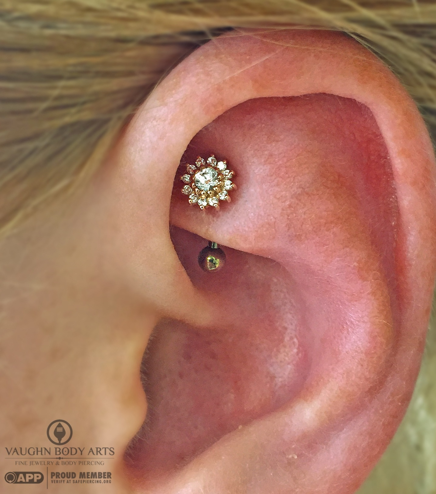 """Rook piercing with a 14k rose gold """"Rose"""" end featuring clear cz's from BVLA."""