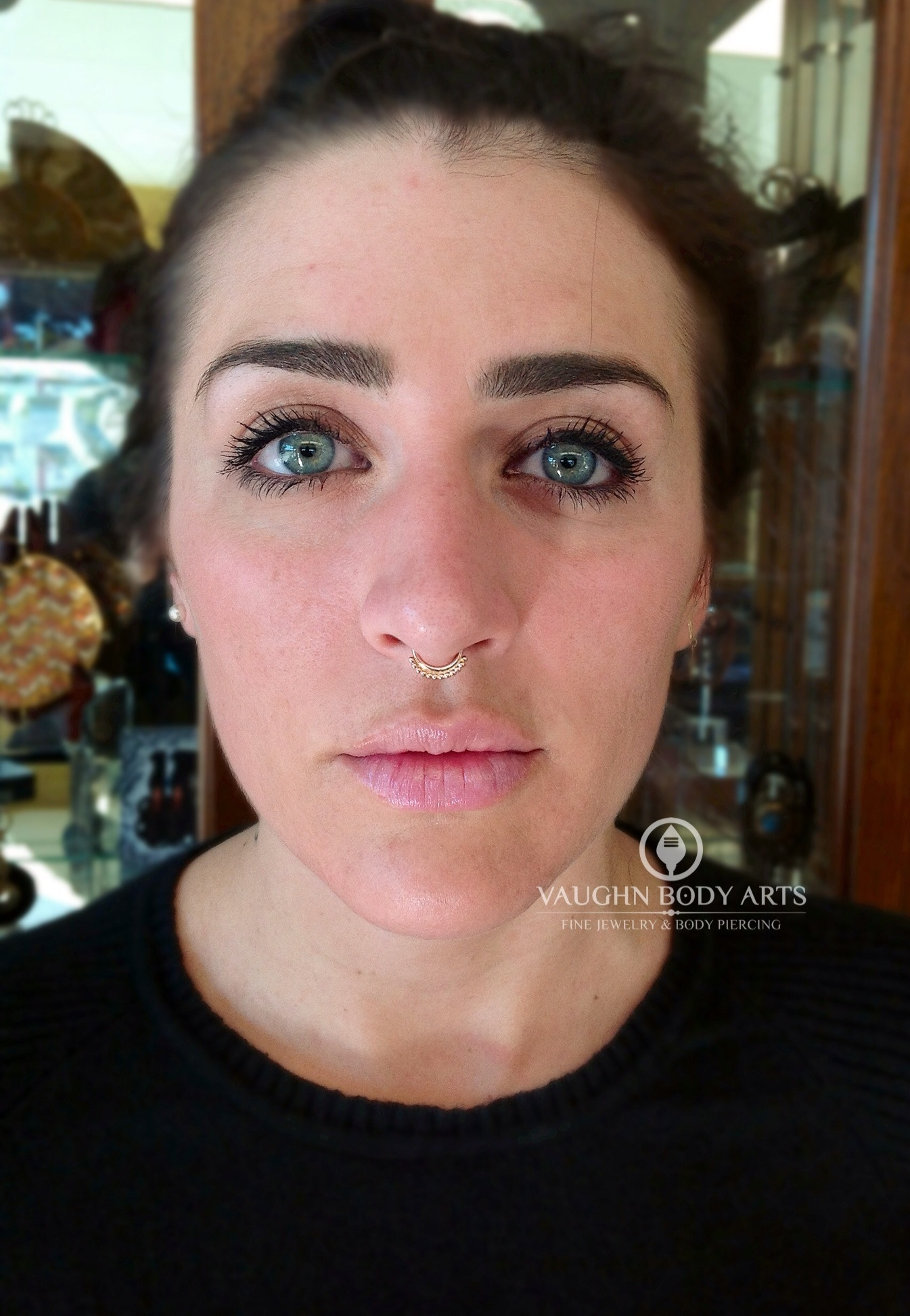 """Septum piercing with a 14k yellow gold """"Latchmi"""" ring from BVLA."""