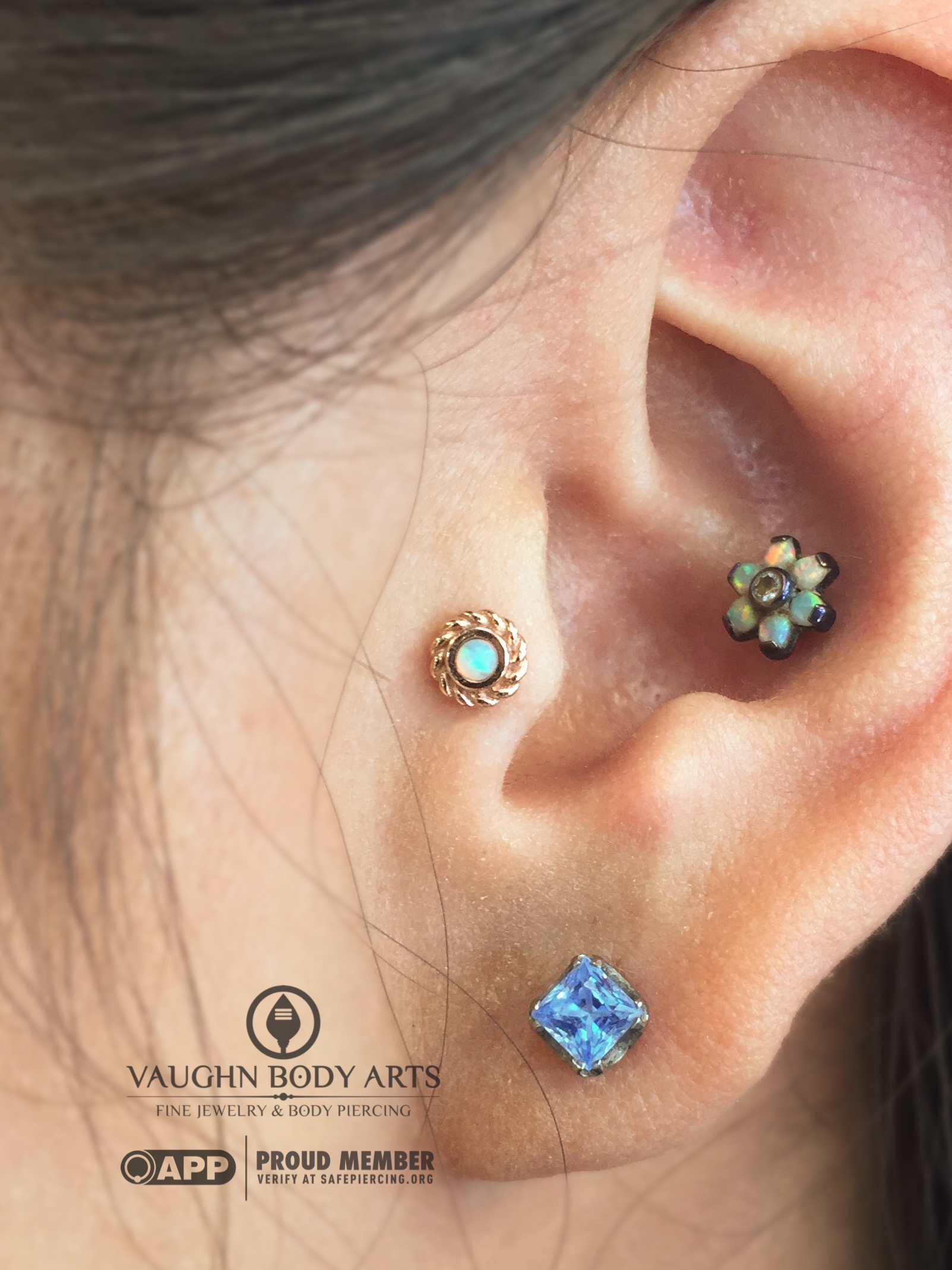 """Tragus piercing with a 14k yellow gold and opal """"Mini Choctaw"""" end from BVLA."""