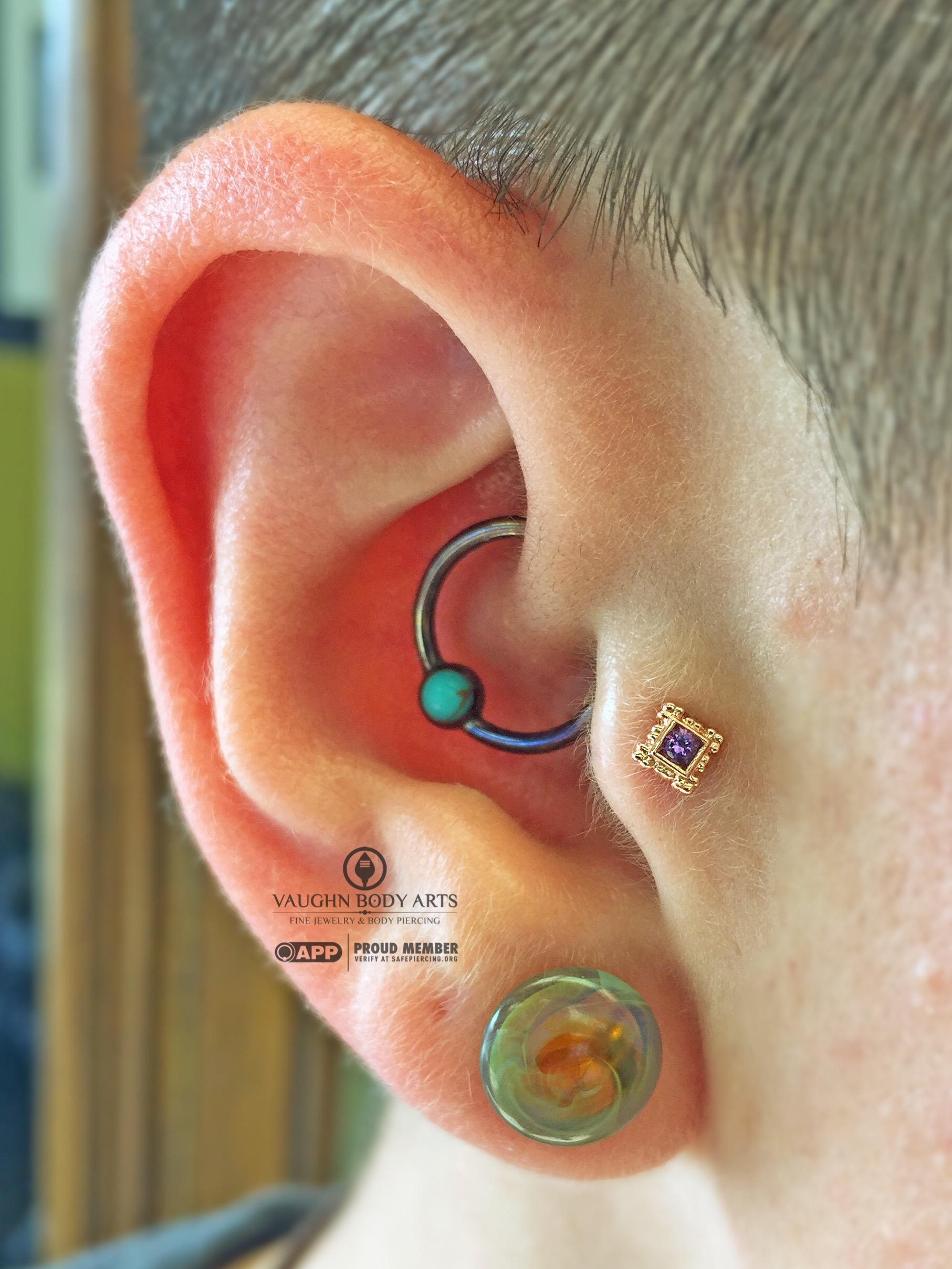 """Tragus piercing featuring a 14k rose gold and amethyst """"Flourish Illusion"""" end from BVLA."""