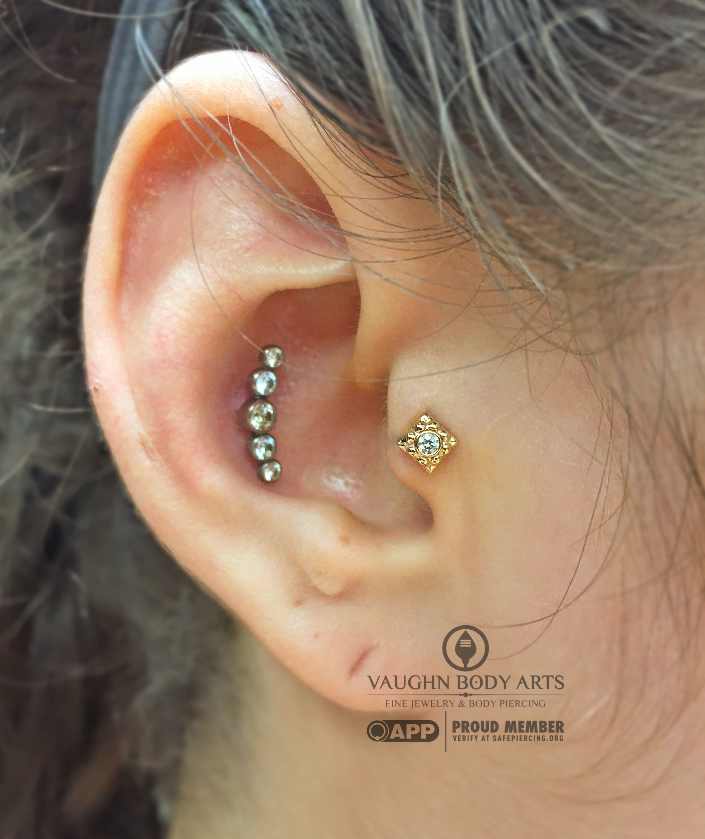"""Tragus piercing with an 18k yellow gold and cz """"Kira"""" end from Anatometal."""