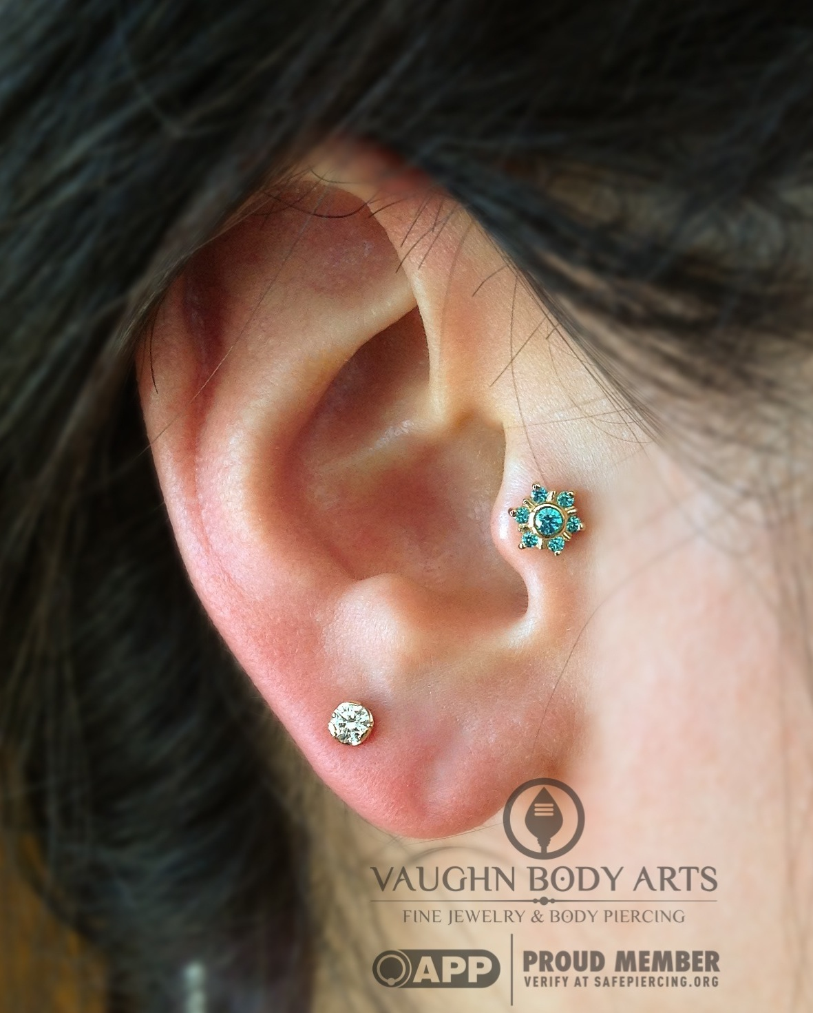 """Tragus piercing with a 14k yellow gold and mint green cz """"Toltec"""" end from BVLA."""