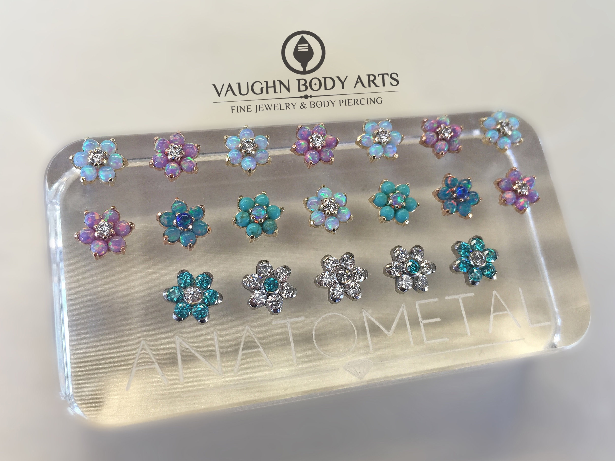 Selection of titanium and 18k gold flower ends from Anatometal.