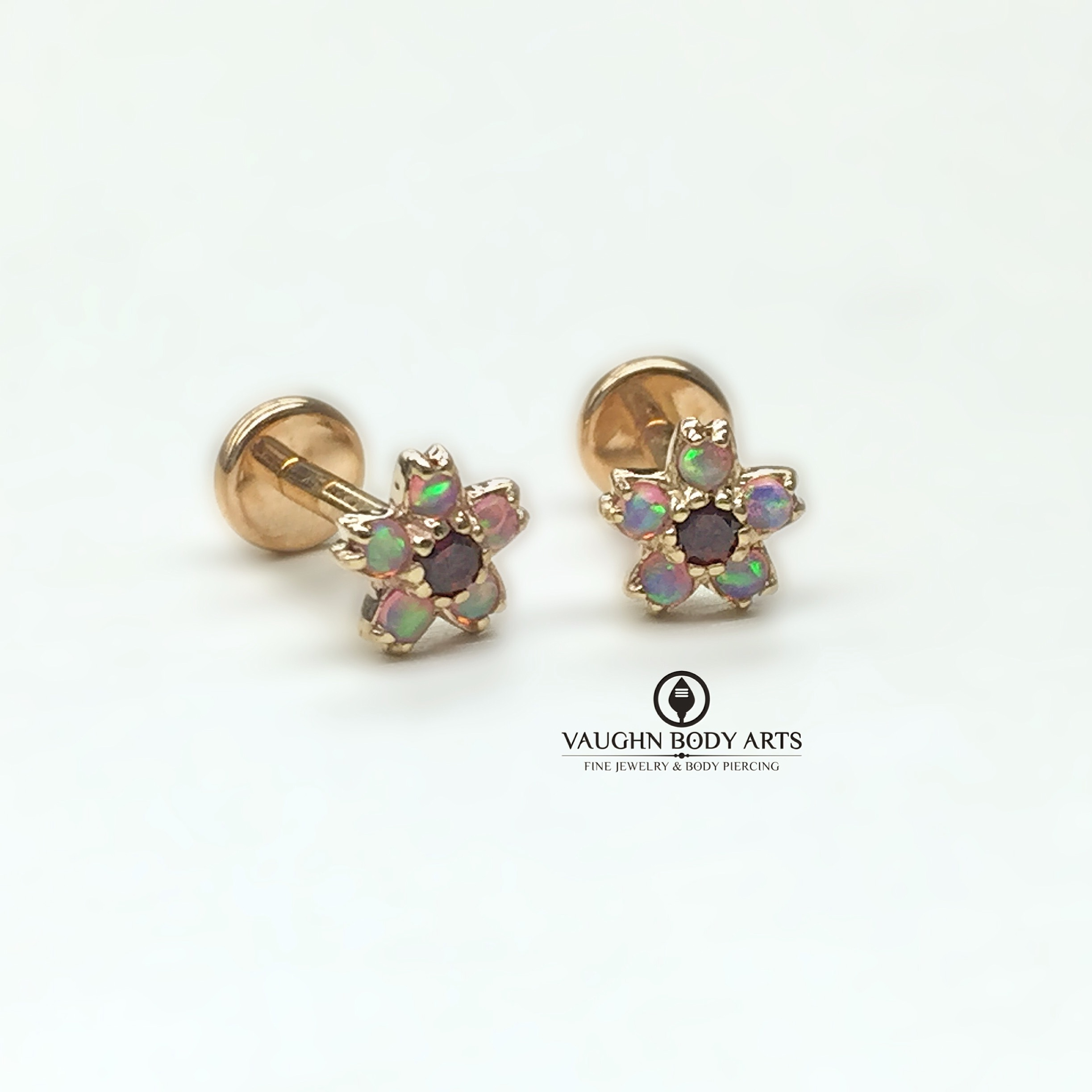 "14k yellow gold ""Cherry Blossom"" ends from BVLA featuring pink opals and garnets."