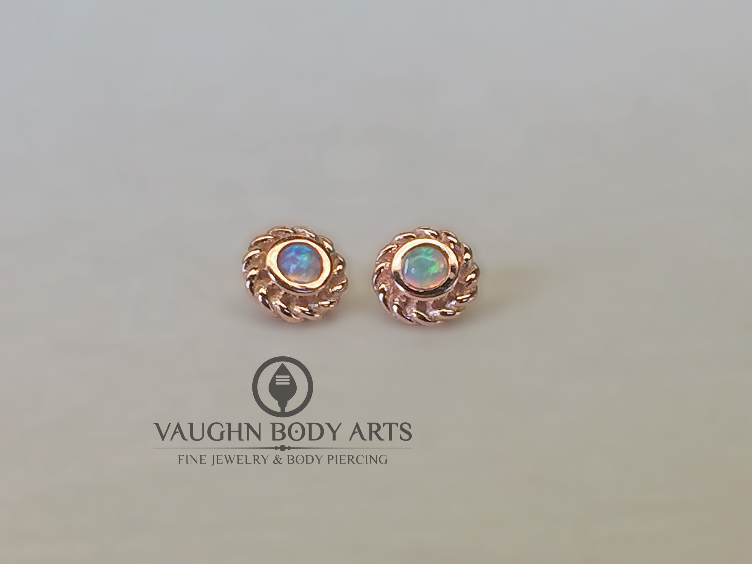 "14k rose gold ""Mini Choctaw"" ends from BVLA featuring synthetic white opals."
