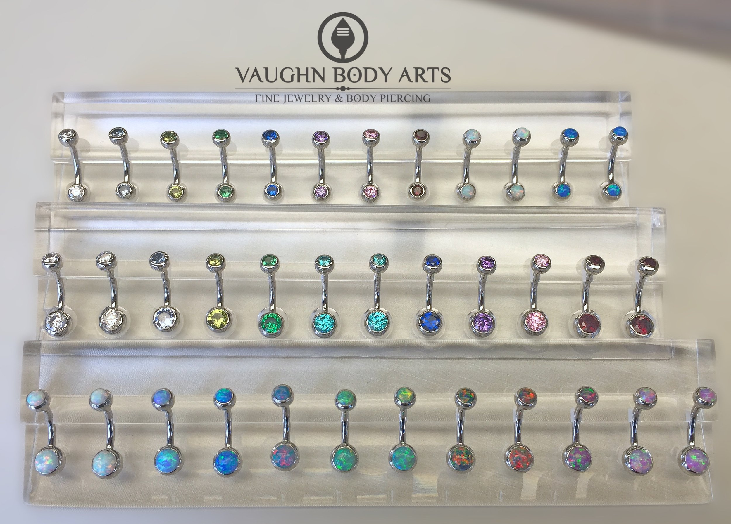 Selection of titanium navel curves from Anatometal.