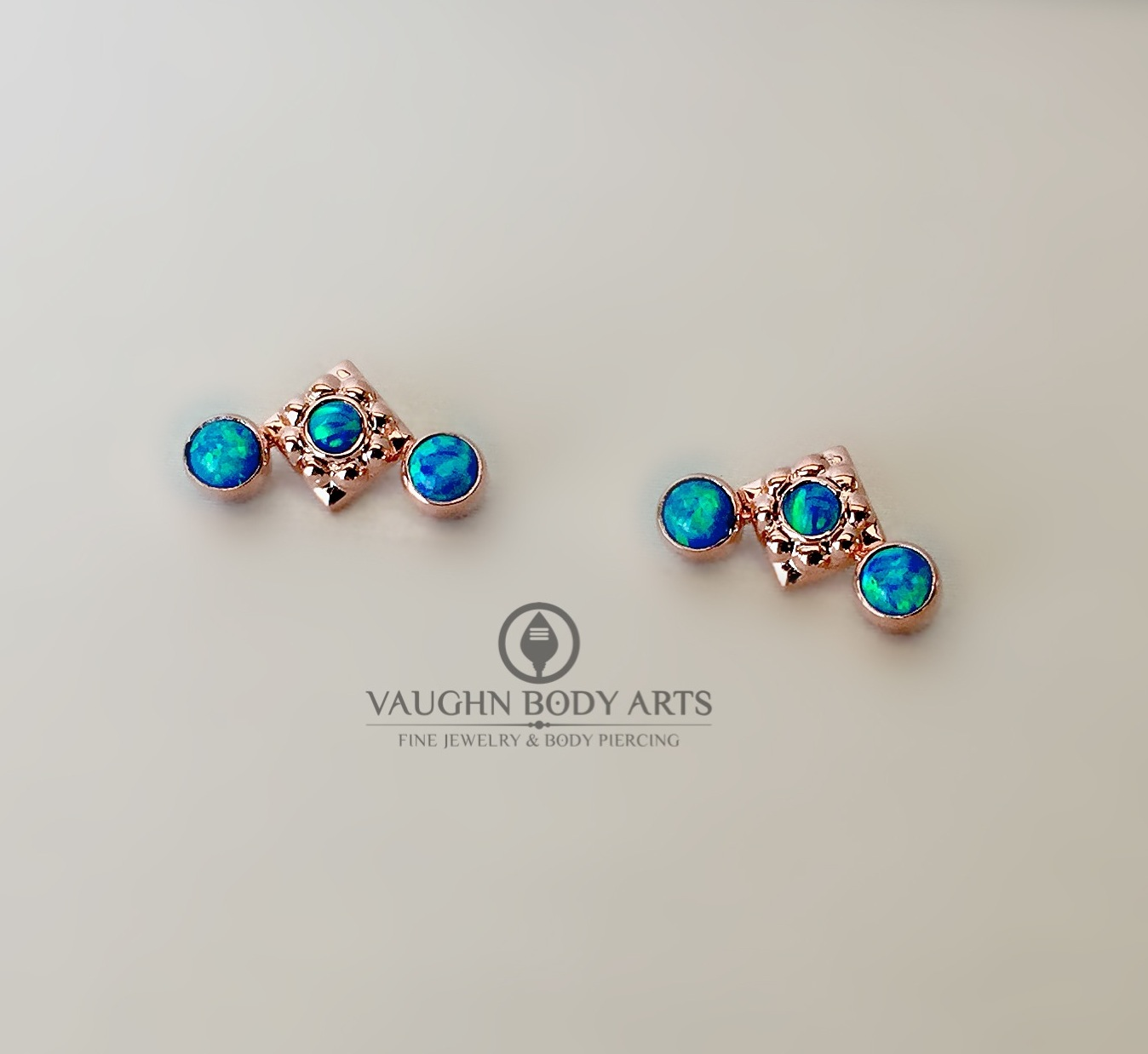 "18k rose gold ""Kira"" clusters from Anatometal featuring synthetic dark blue opals."