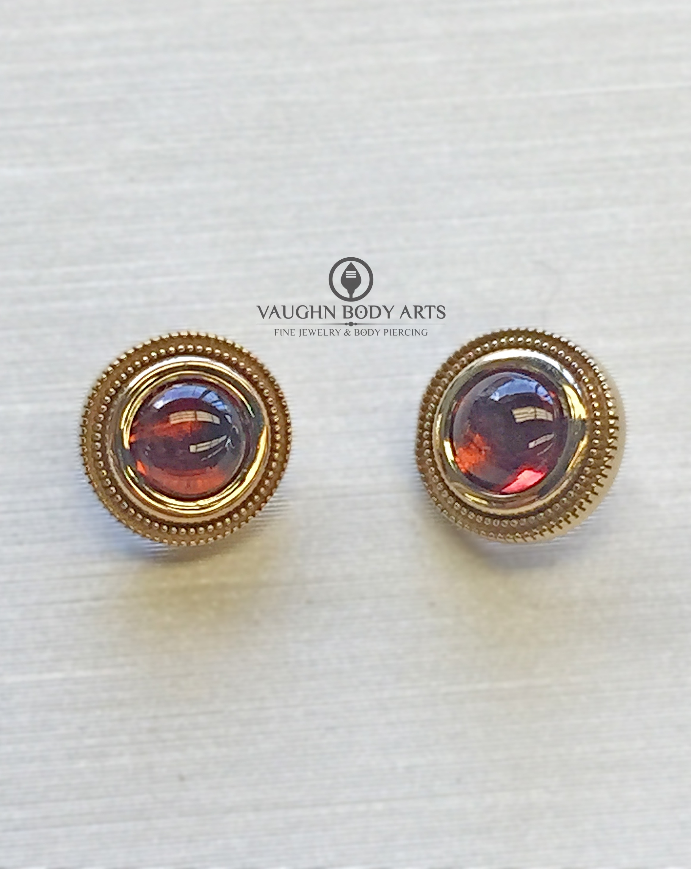 "14k bezel ""Millgrain"" ends from BVLA featuring genuine garnet cabochons."