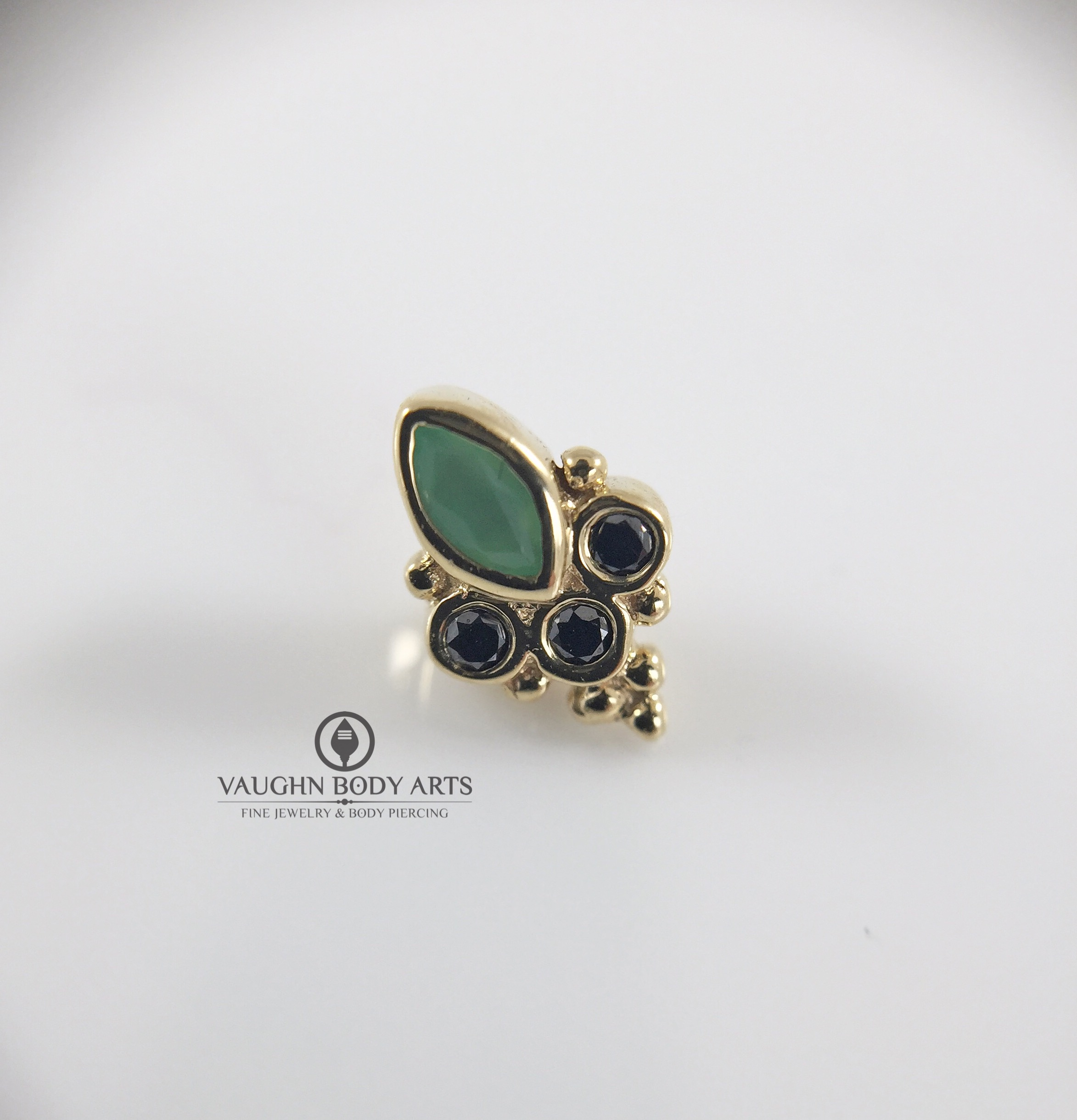 """Marquise Sarai"" end from BVLA in 14k yellow gold featuring a marquise-cut chrysoprase and genuine black diamonds."