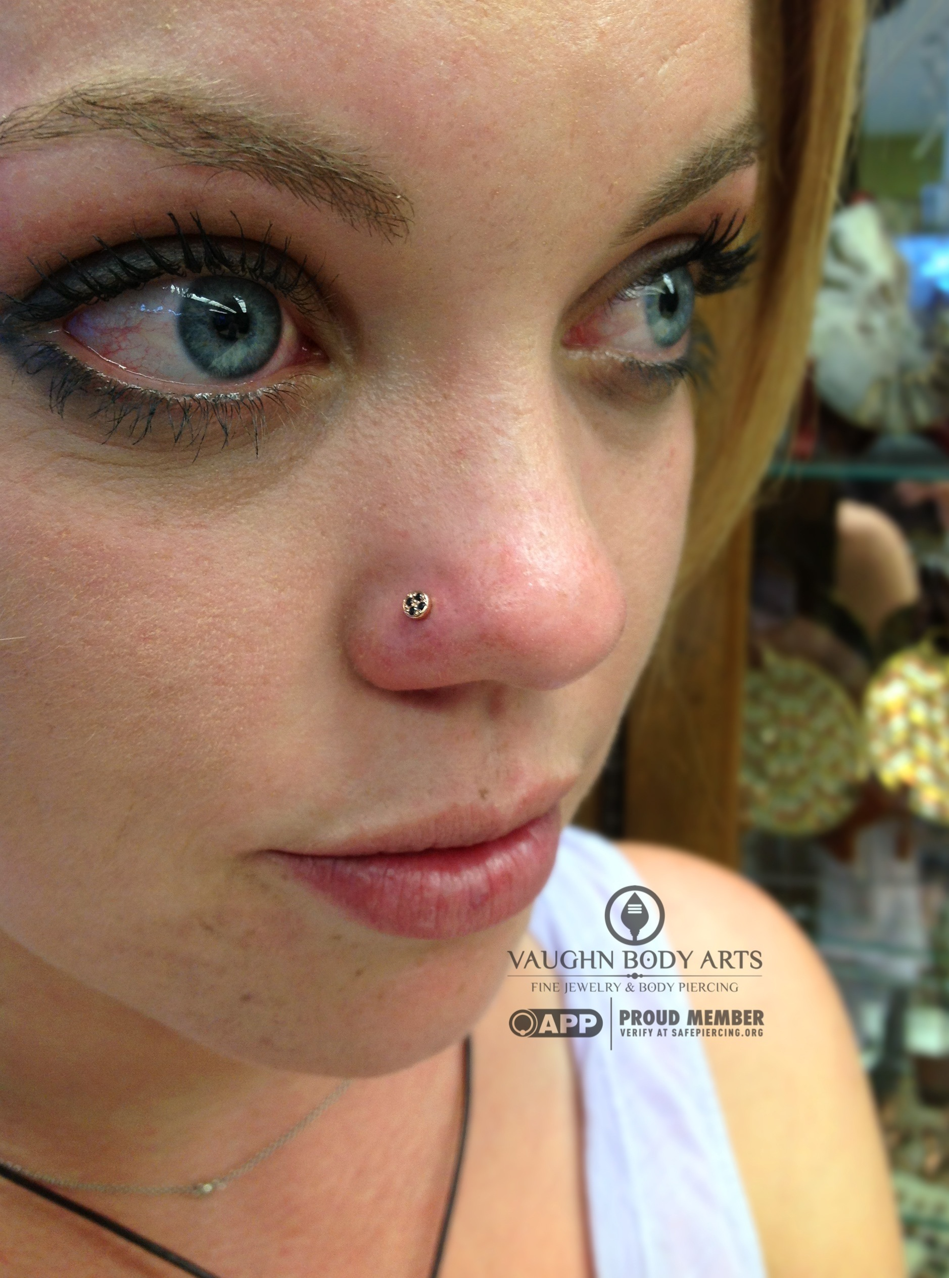 """Nostril piercing with a 14k yellow gold and black cz """"Micro Pave Disk"""" from BVLA."""