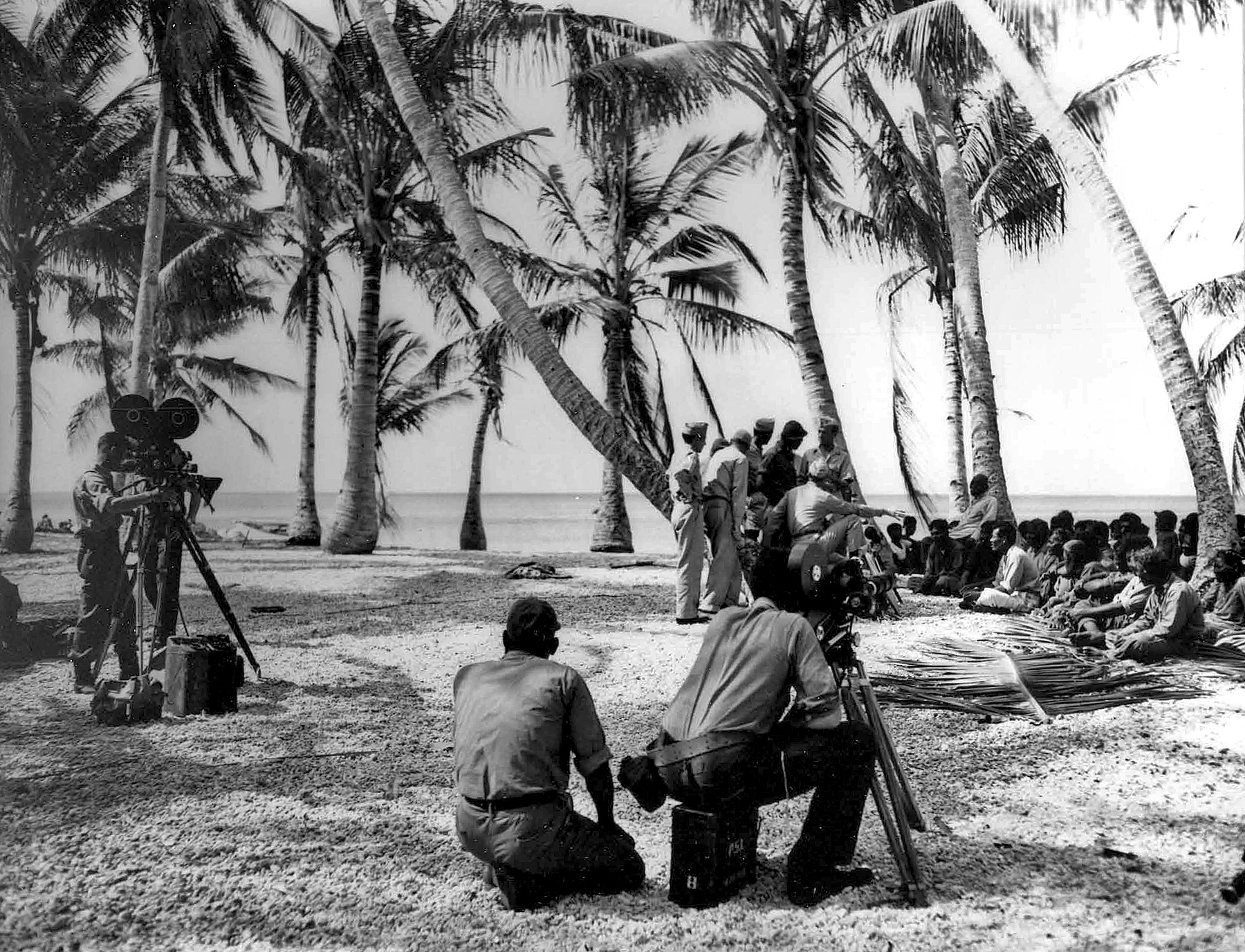 "The multi-camera filming of Commodore Wyatt ""consulting"" the Bikinians about their evacuation on March 6, 1946. (NARA, Still Pictures Unit, Record Group 374-G, box 7, folder 60 ""Tests: Operation Crossroads"")"