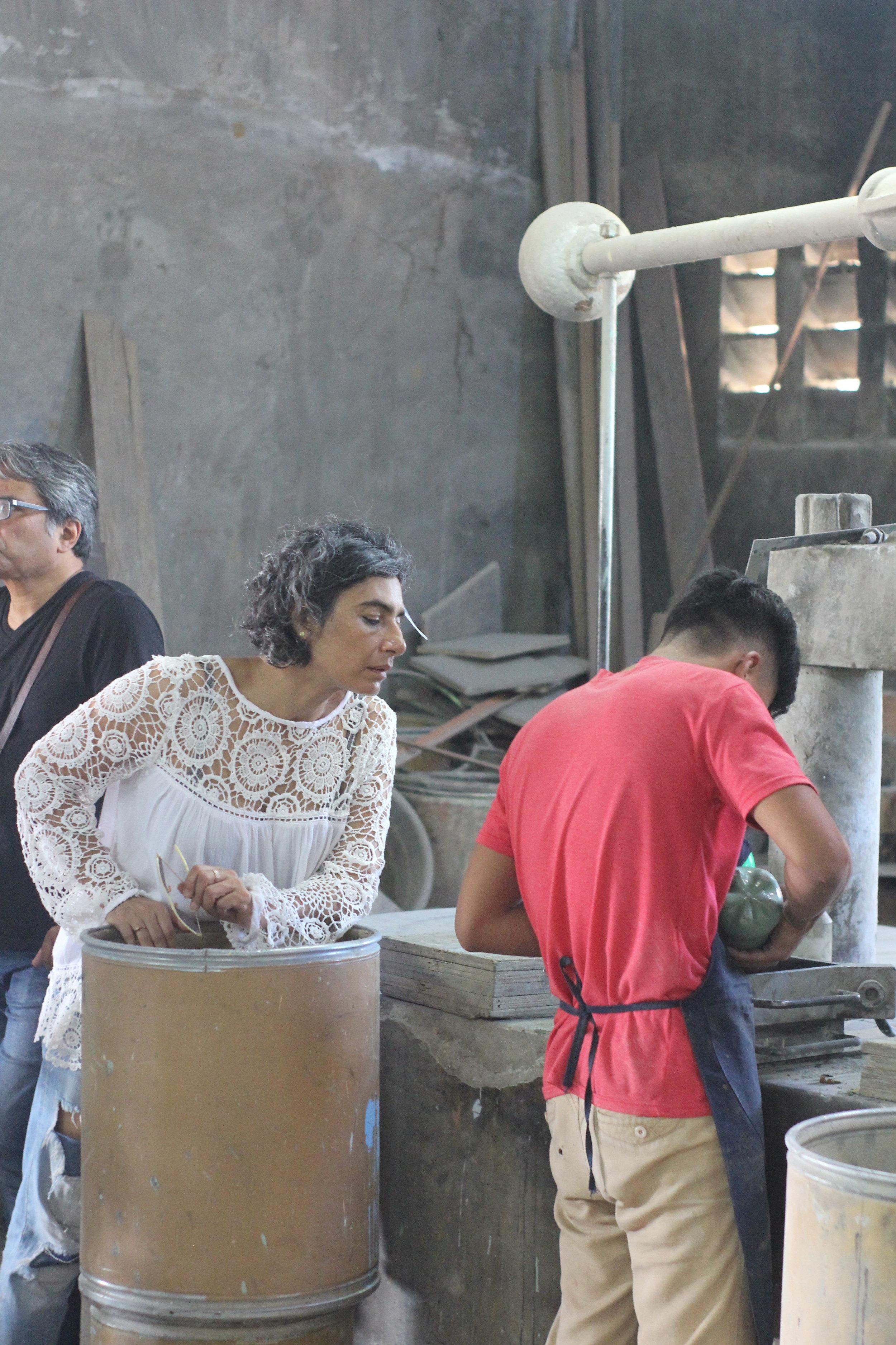 Tour of Las Casas artisan workshops. Here, Monica observes cement tile production.