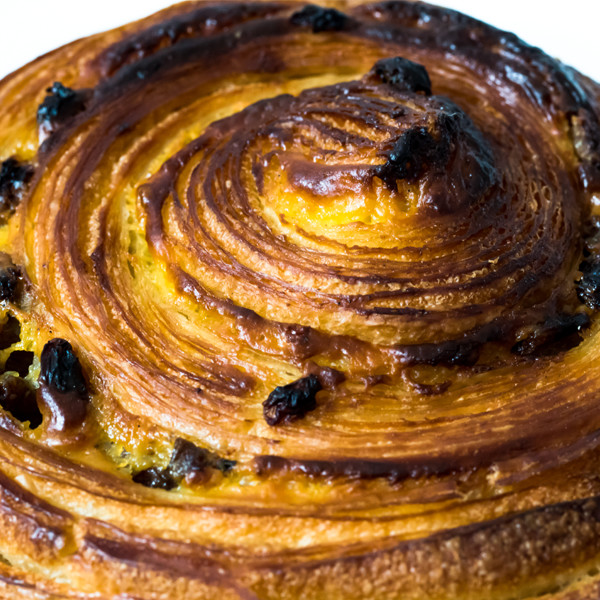 Pain Aux Raisins  With crème patissière and tea-soaked raisins. It's hard to chose between the crispy edge and the squidgy custard middle.